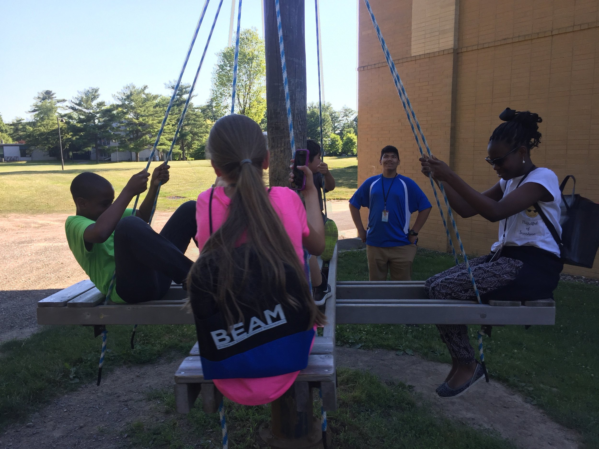 BEAM students on swing outside Student Center.