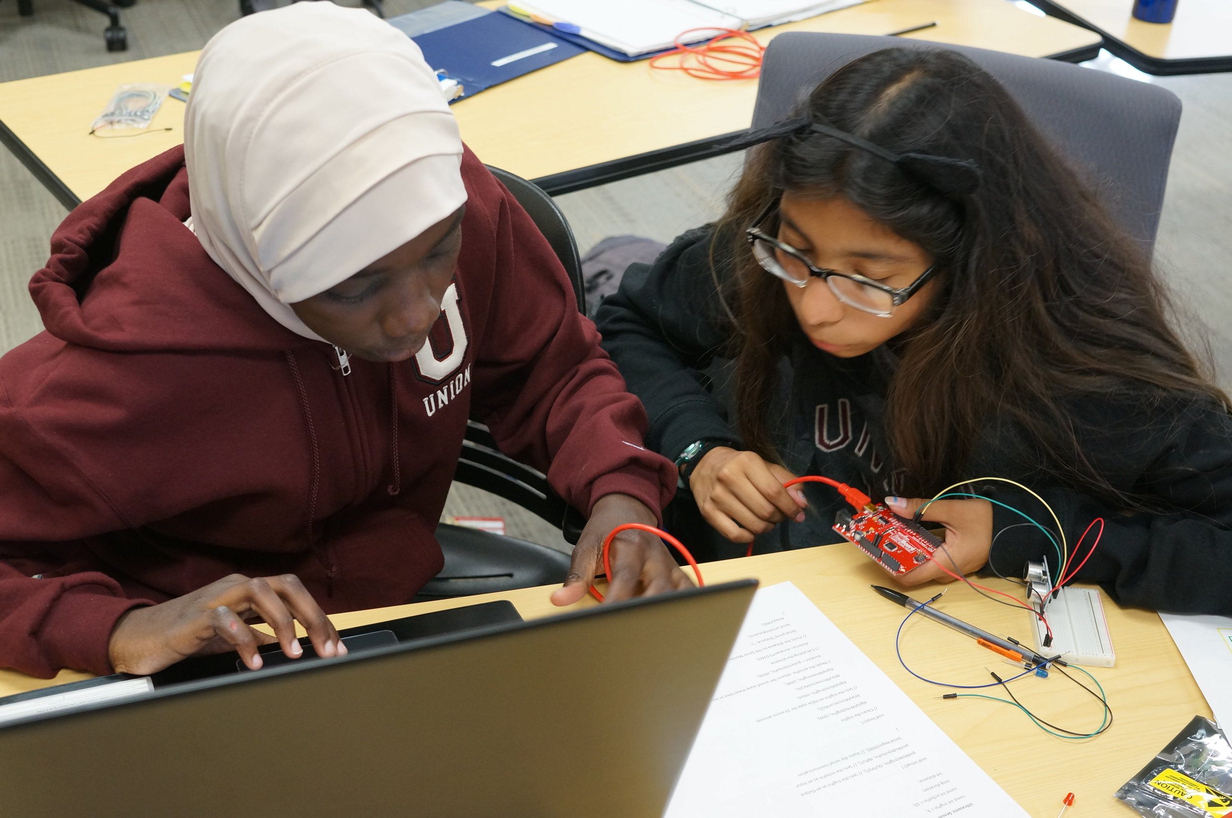 Zeina and Rose code together in Arduino.