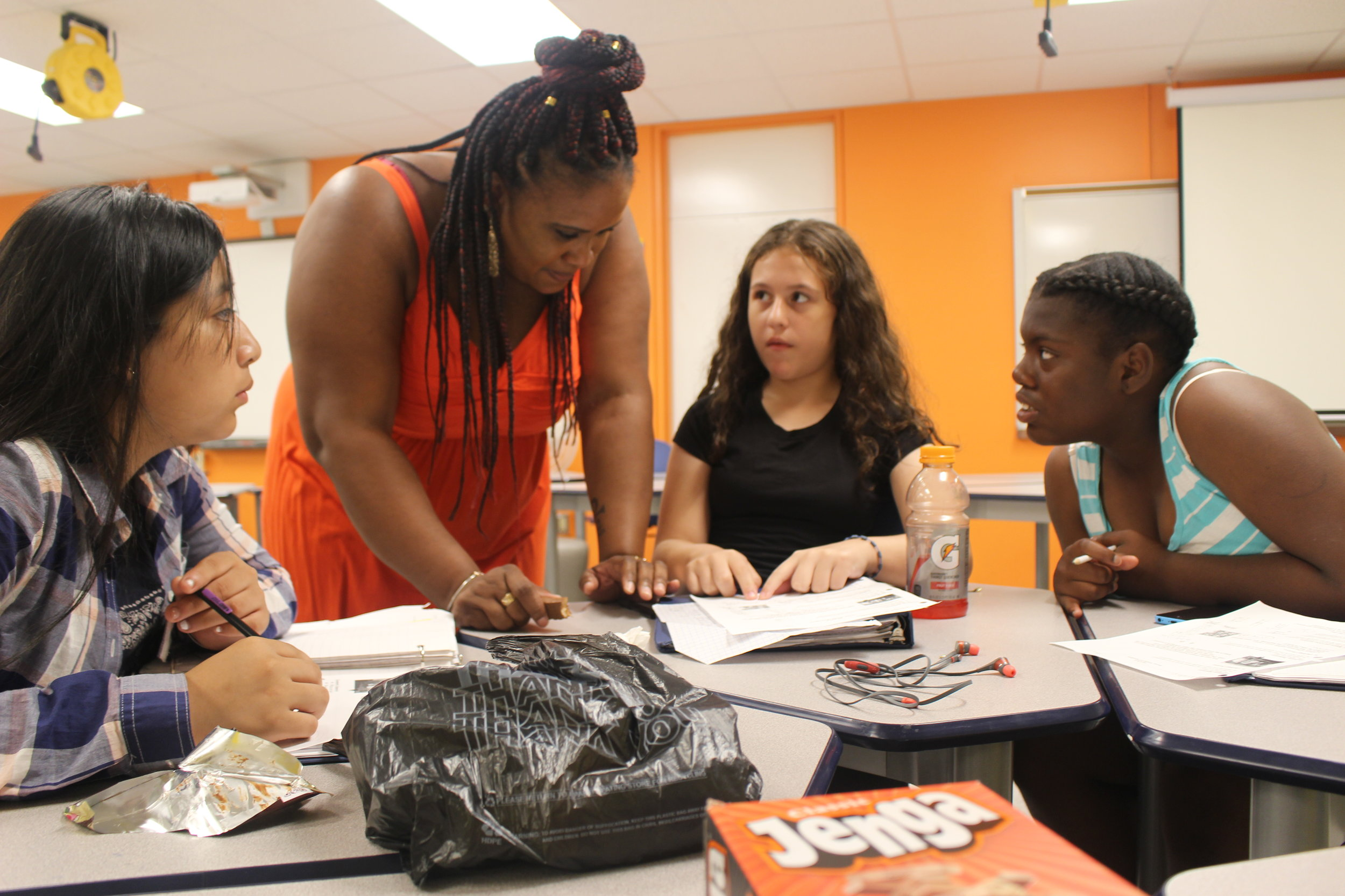 Emily, Jailyn, and Klaudia ask faculty member Giselle about the Fibonacci numbers at the non-residential program BEAM Discovery in New York City.  Banner at top: Faculty member Cory discusses sets and bijections with Diven at the residential program BEAM Summer Away in upstate New York.