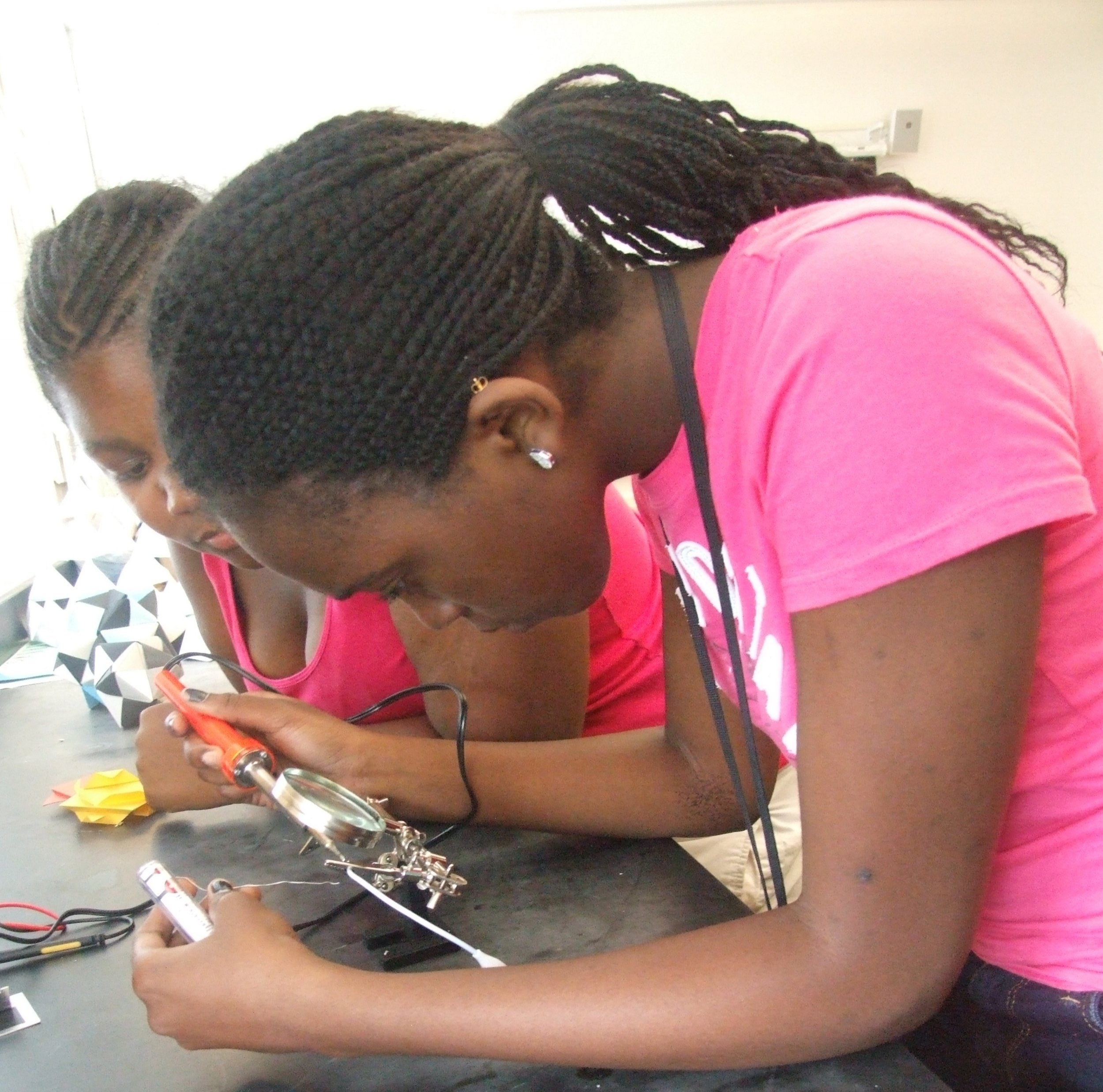 Aisha and Shikya learn to solder, July 2013