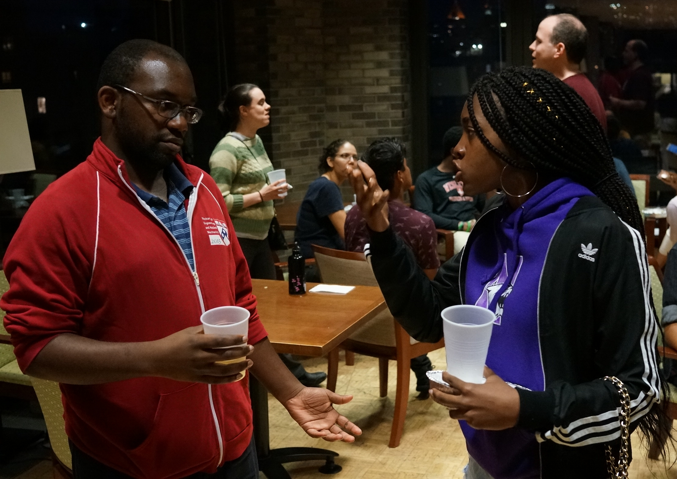 Aisha (right) discusses college plans with Ayinde, BEAM's College Support Coordinator.