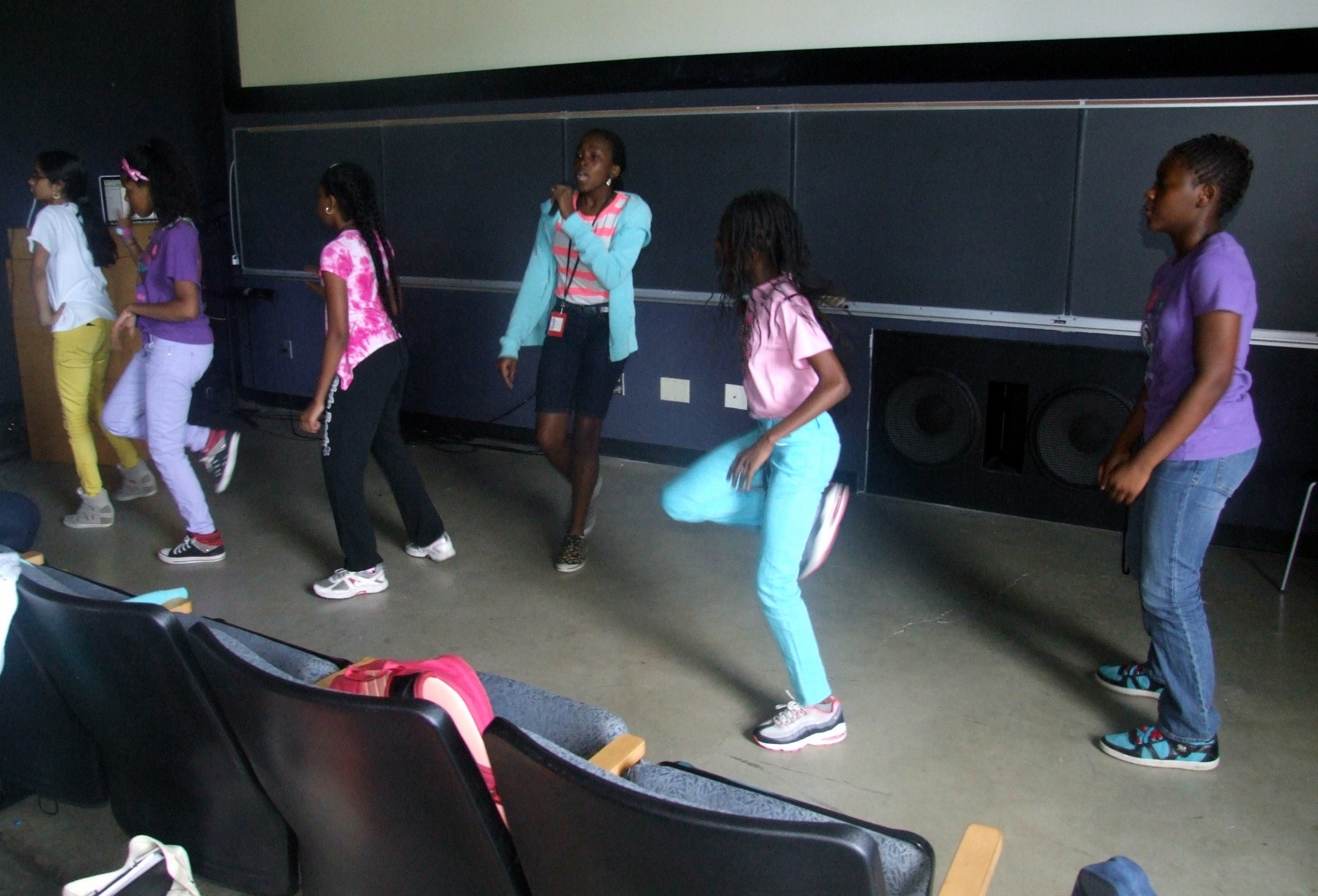 Aisha (center) rehearses for the BEAM 7 talent show back in 2013.