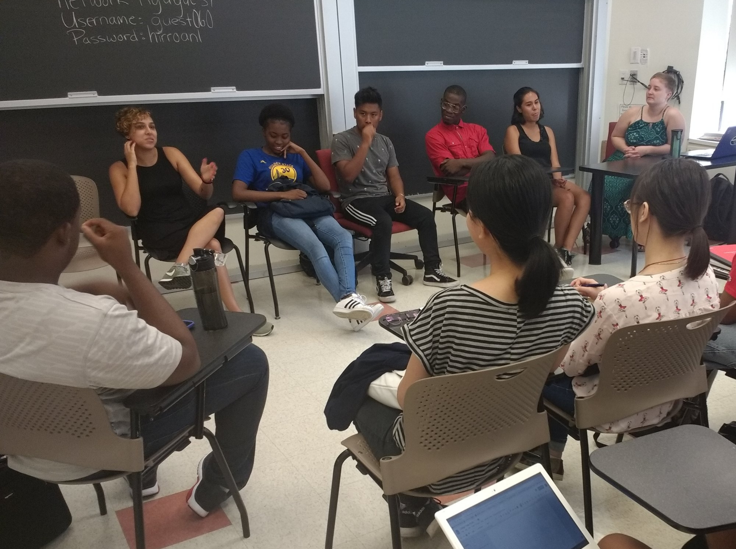 Aisha, front, second from left, sits on a panel of BEAM staff and alums providing college application advice to rising 11th and 12th graders, August 2018.