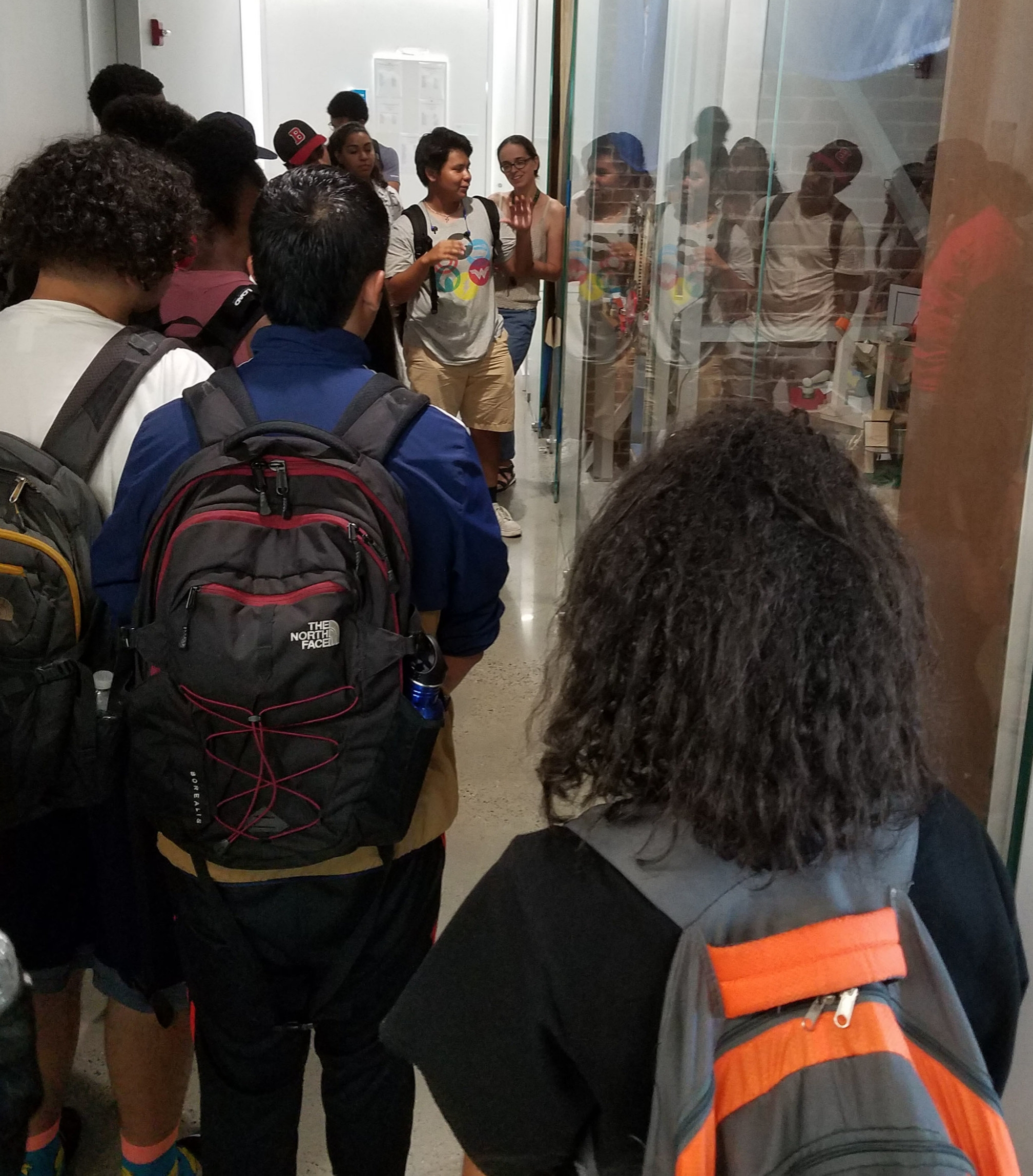 Teo shows his kinetic sculpture to other BEAM 11th and 12th graders during a college tour of Cooper Union.