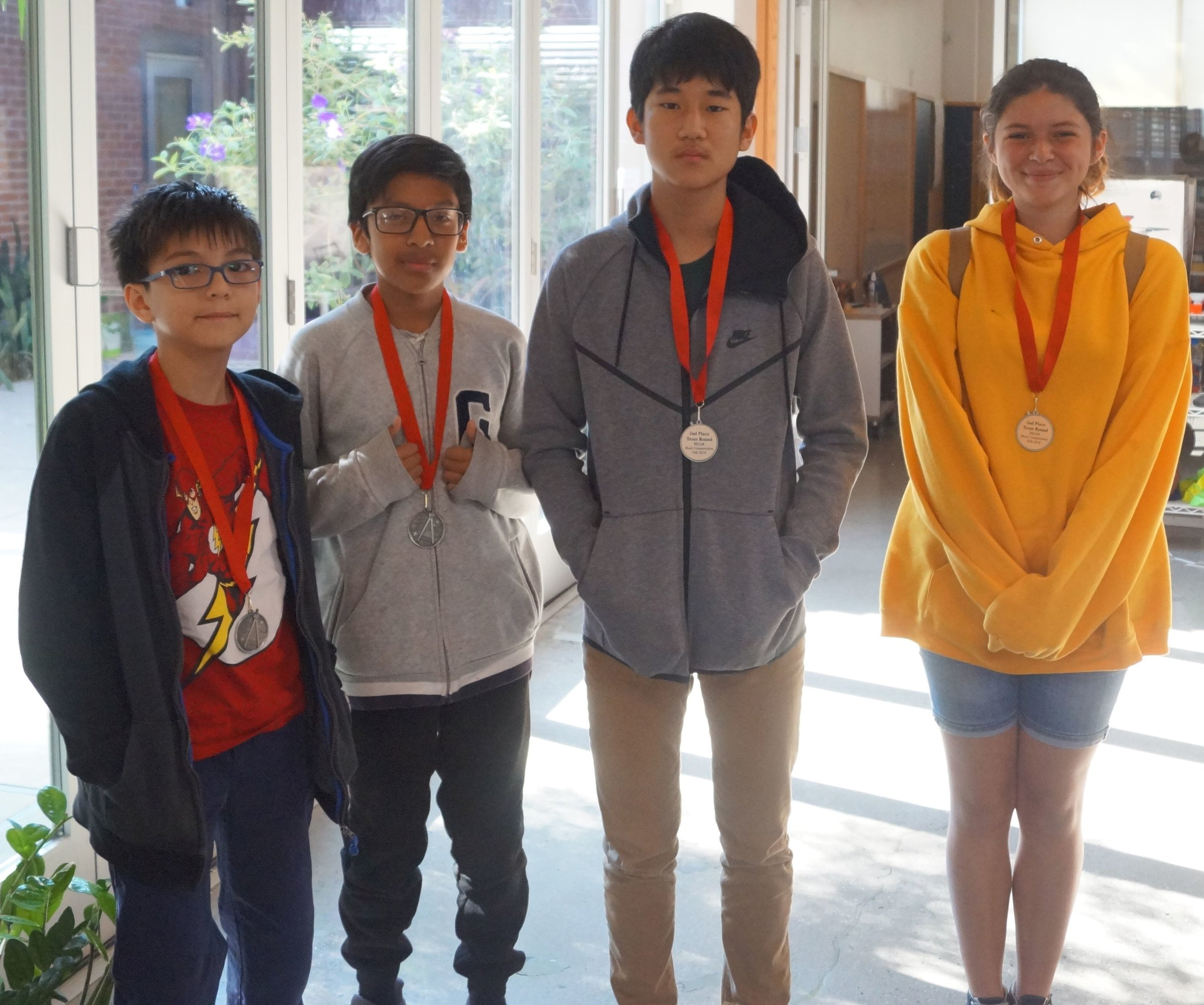 From left to right, Jipper, Abraham, Joshua, and Cherokee, won second place in the team round representing UCLA Community School. Abraham and Cherokee are BEAM alum.