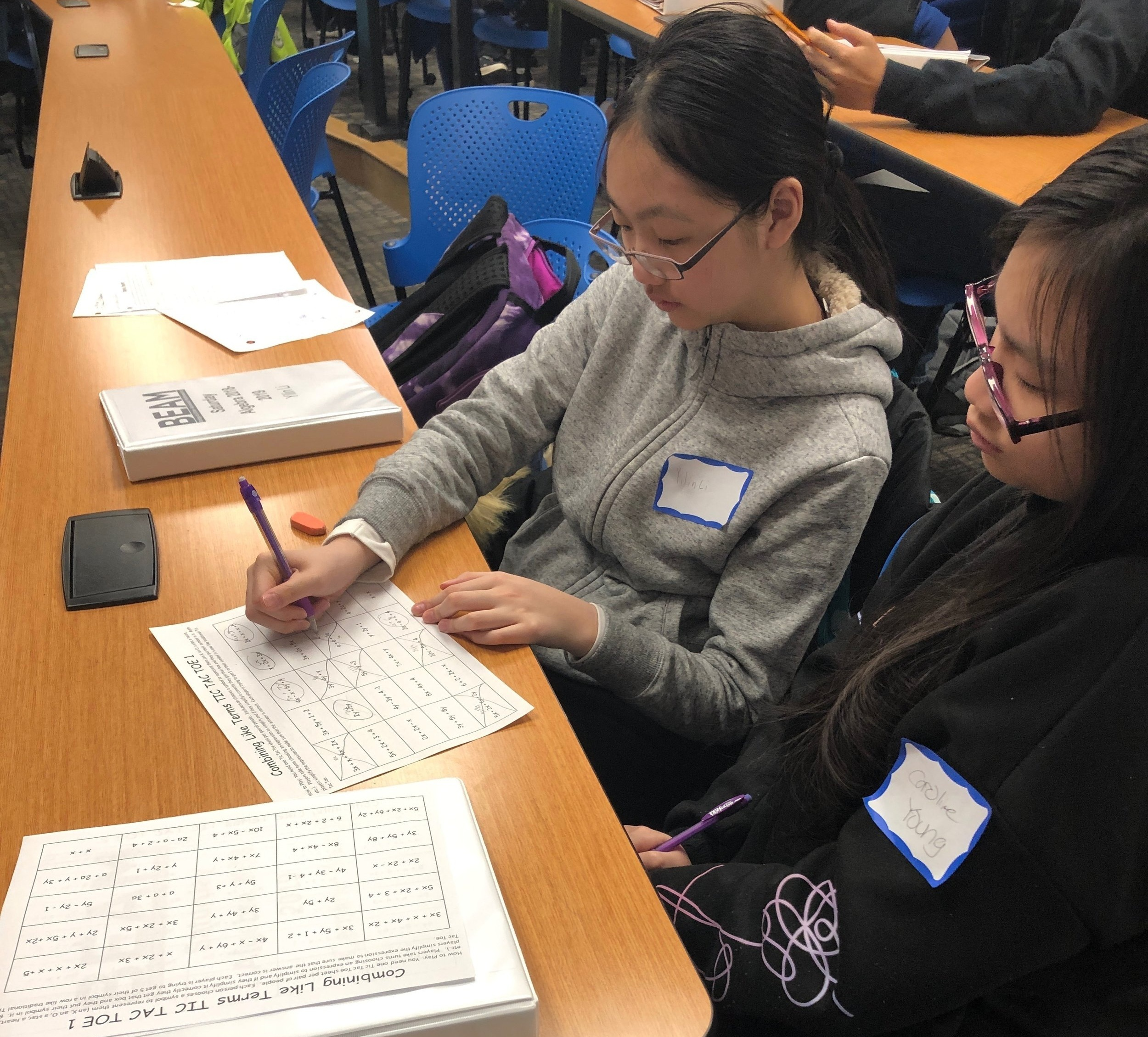 8th grade students Yilin and Caroline team up for a combining like terms game in their Algebra class.