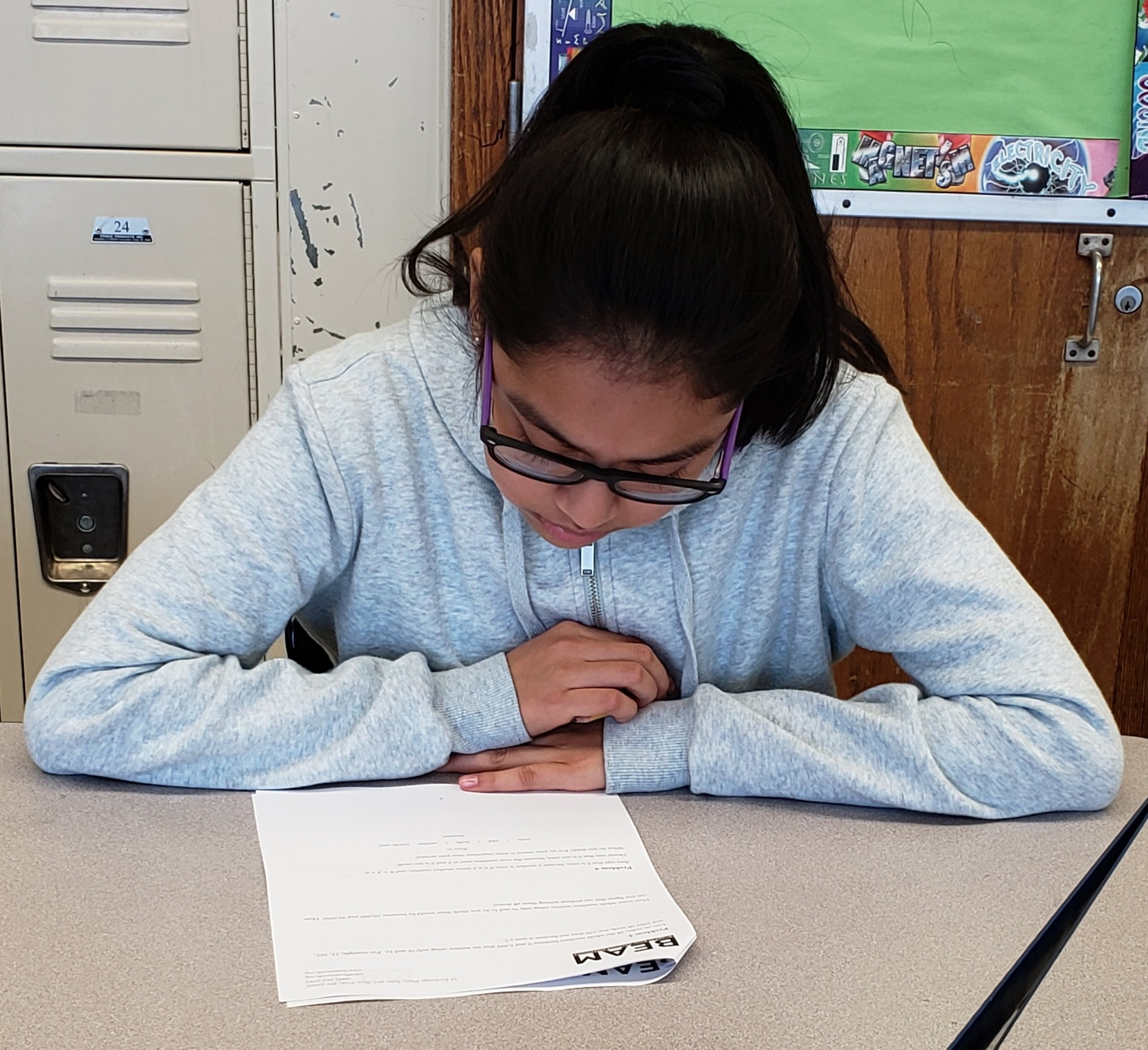 A 7th grader works on the Admissions Challenge.