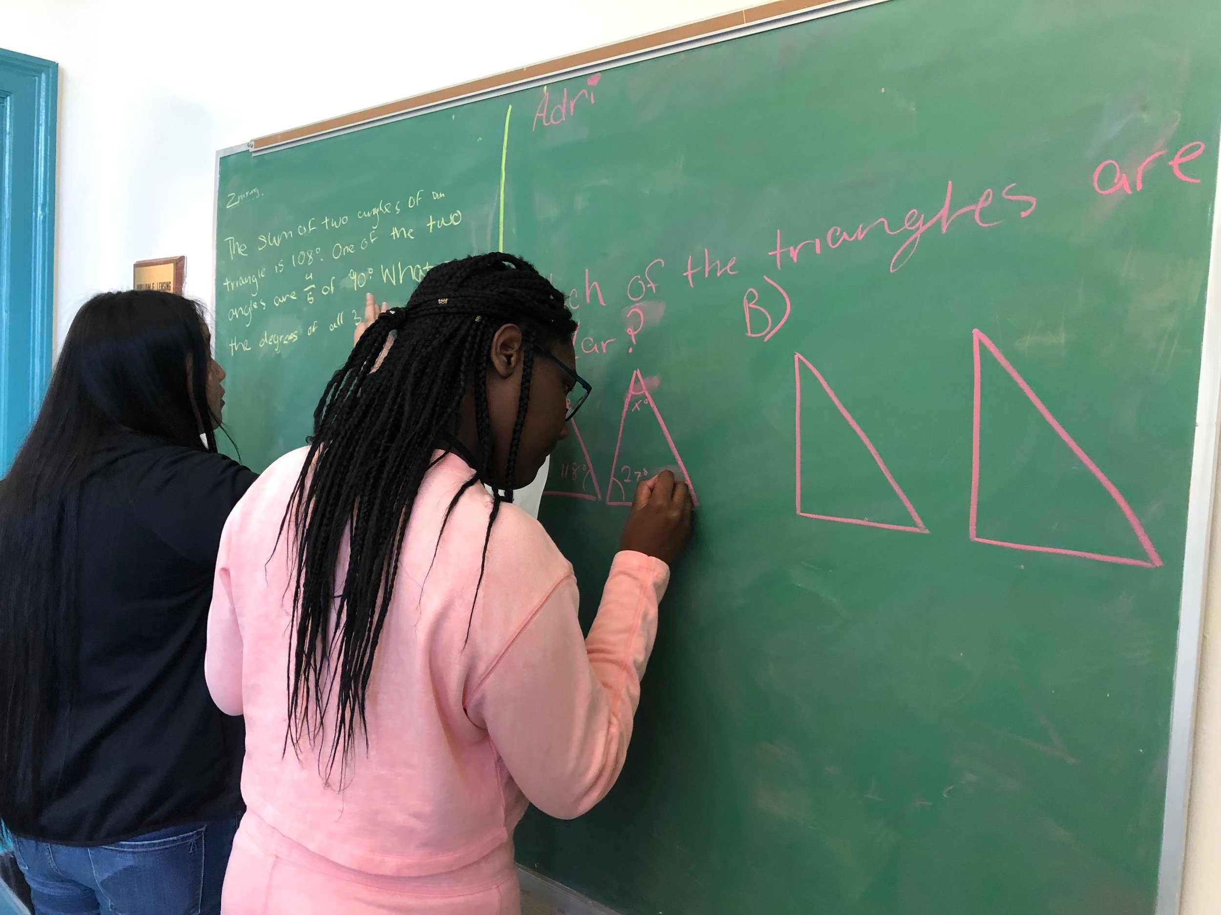 Adri and Zhixing work on problems involving triangles in Geometry.