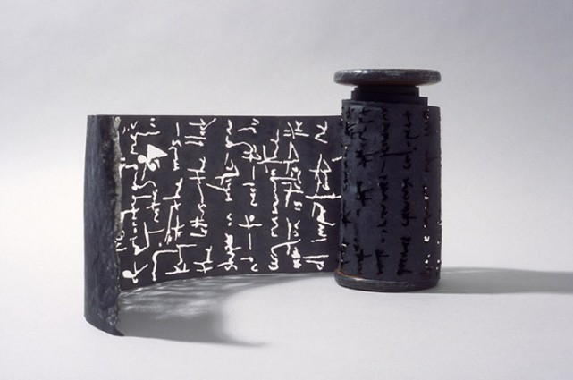 "Black Torah, 2003, graphite, flax paper with text burnt out, 132"" x 6"""