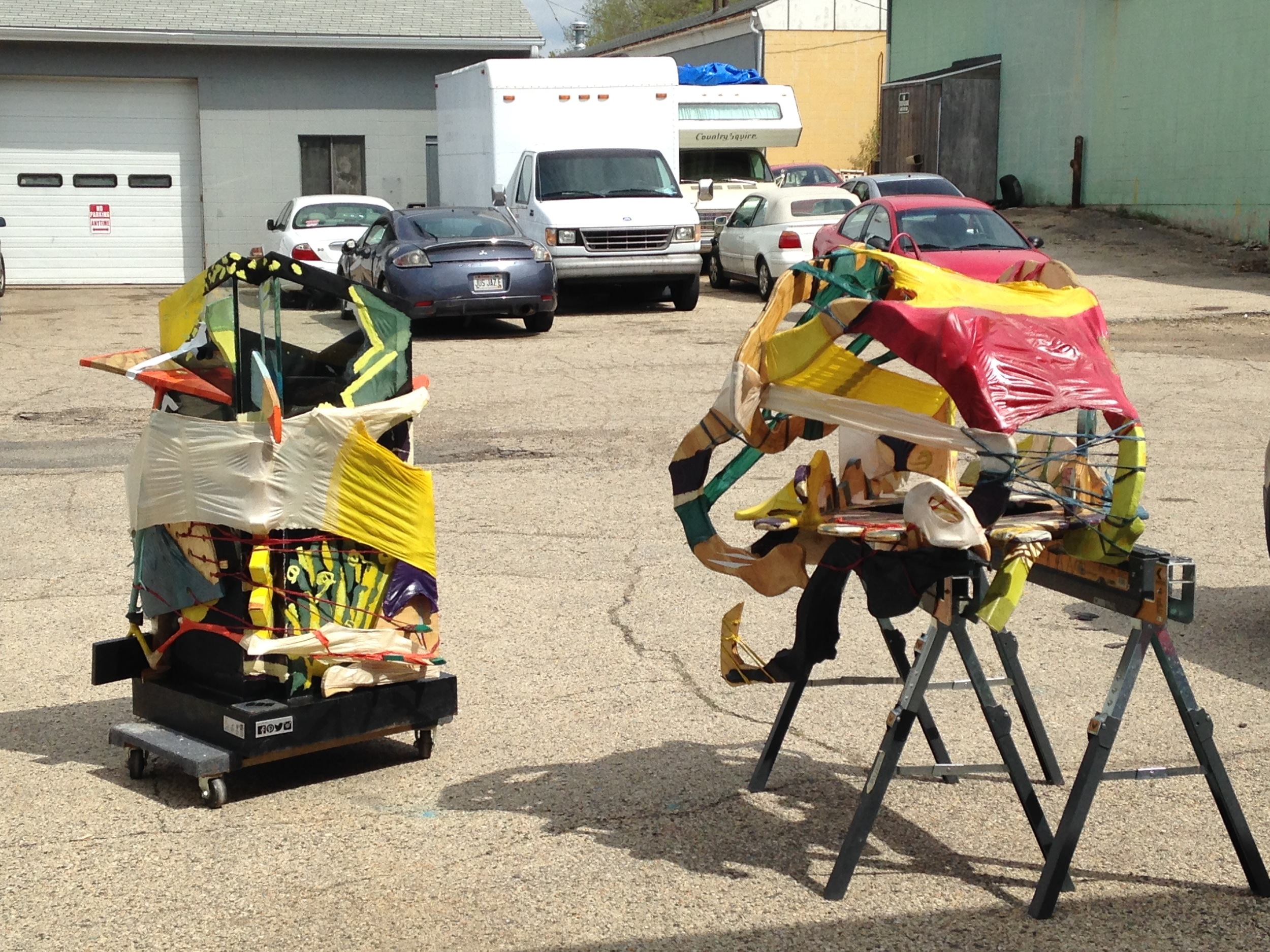Everything drying in the parking lot outside our studio. We varnished everything a lot to be prepared for rain.
