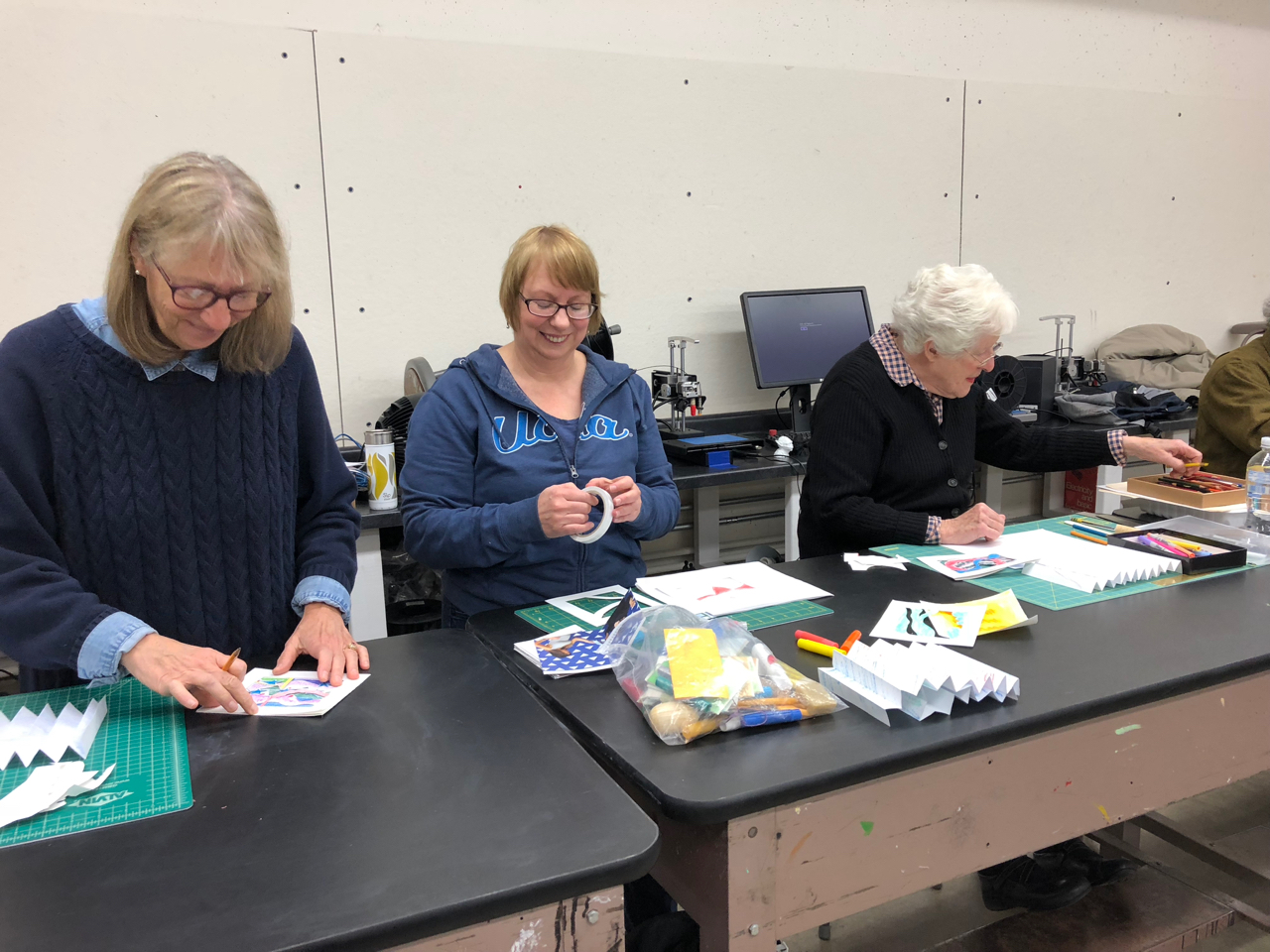 Deborah, April and Judith working on their tunnel books, Cont Ed 2018