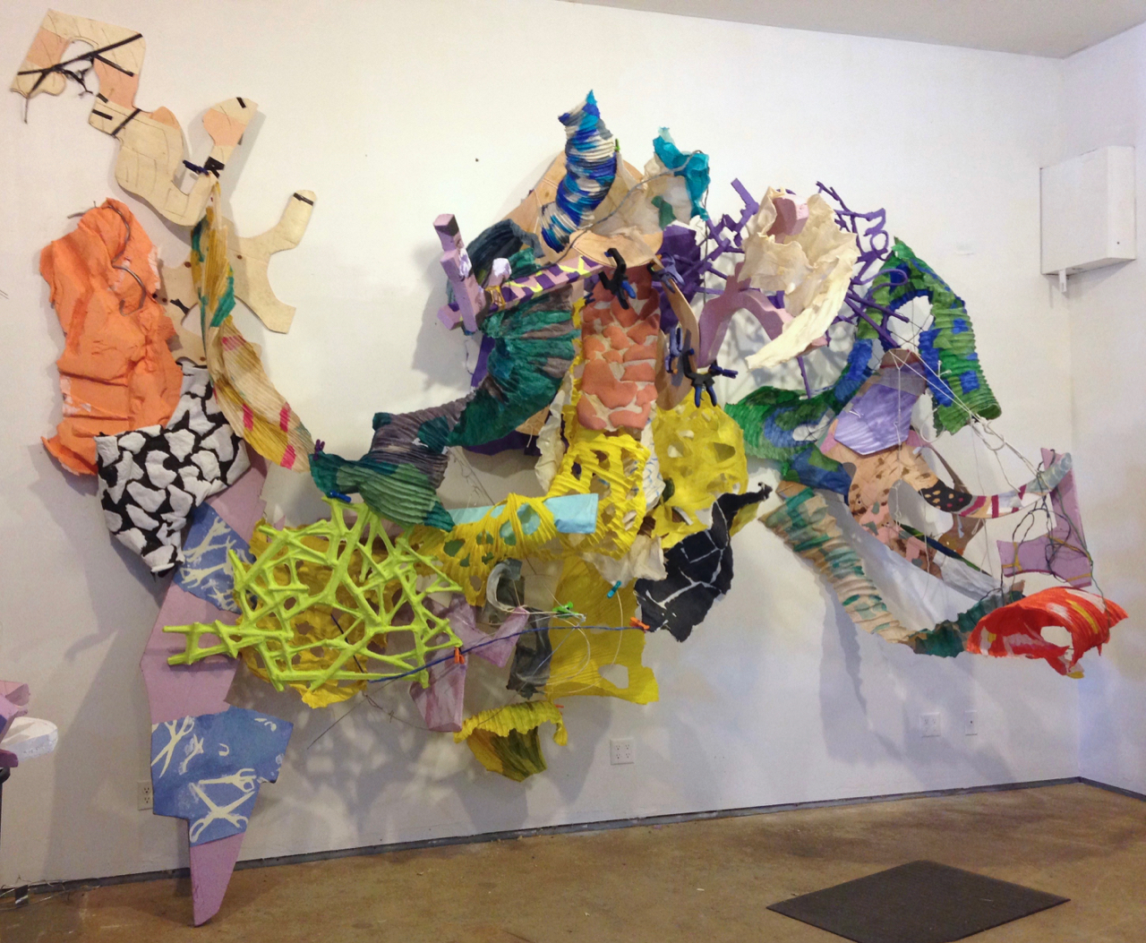 Abaca salad - studio sketch , handmade cast abaca and cotton papers, plywood, wire, pink insulation foam board, rope, 10' x 13' x 5', 2017