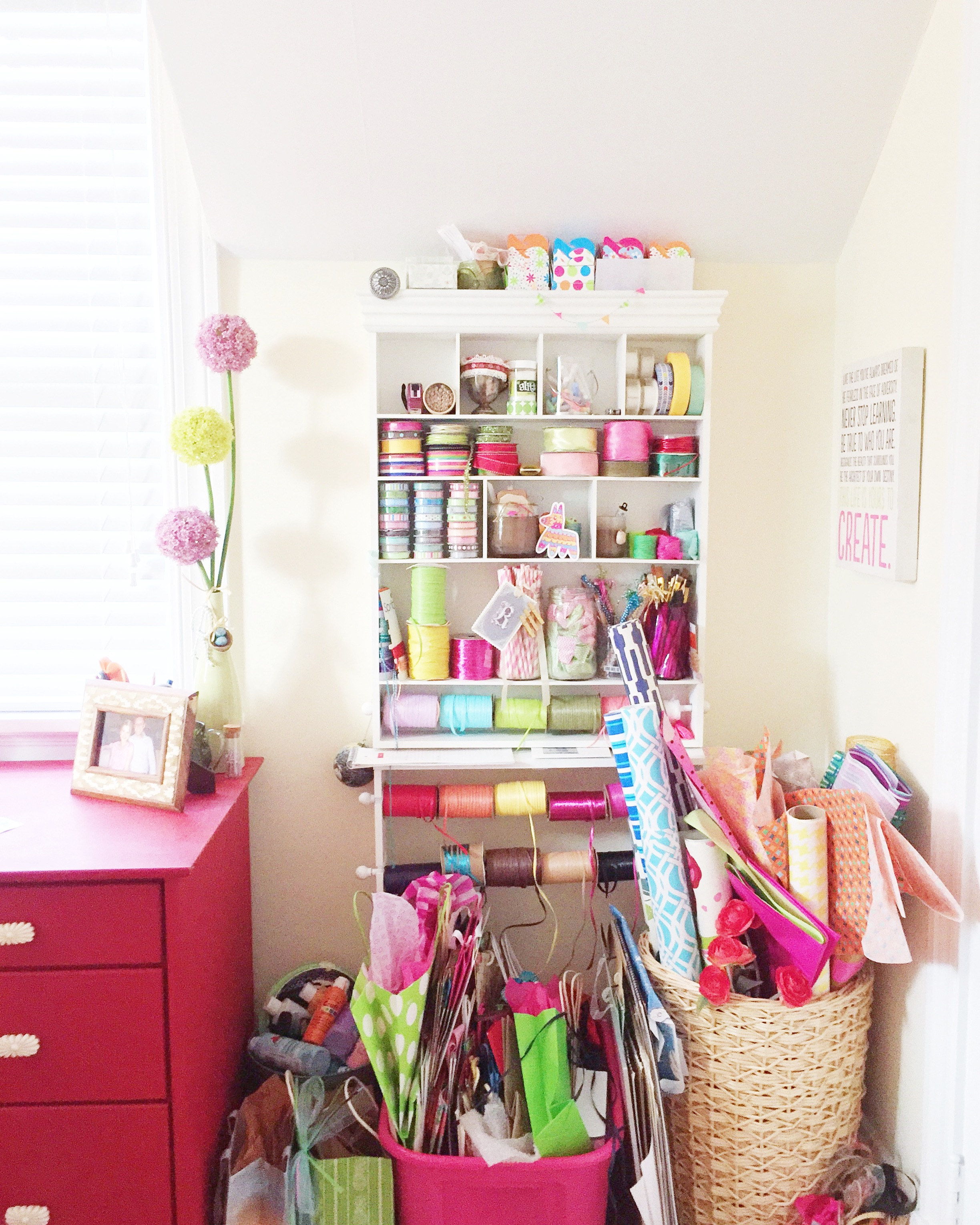 The main craft station including gift wrap, tissue paper, gift bags, ribbon and wraphia, tapes, small boxes and bags.