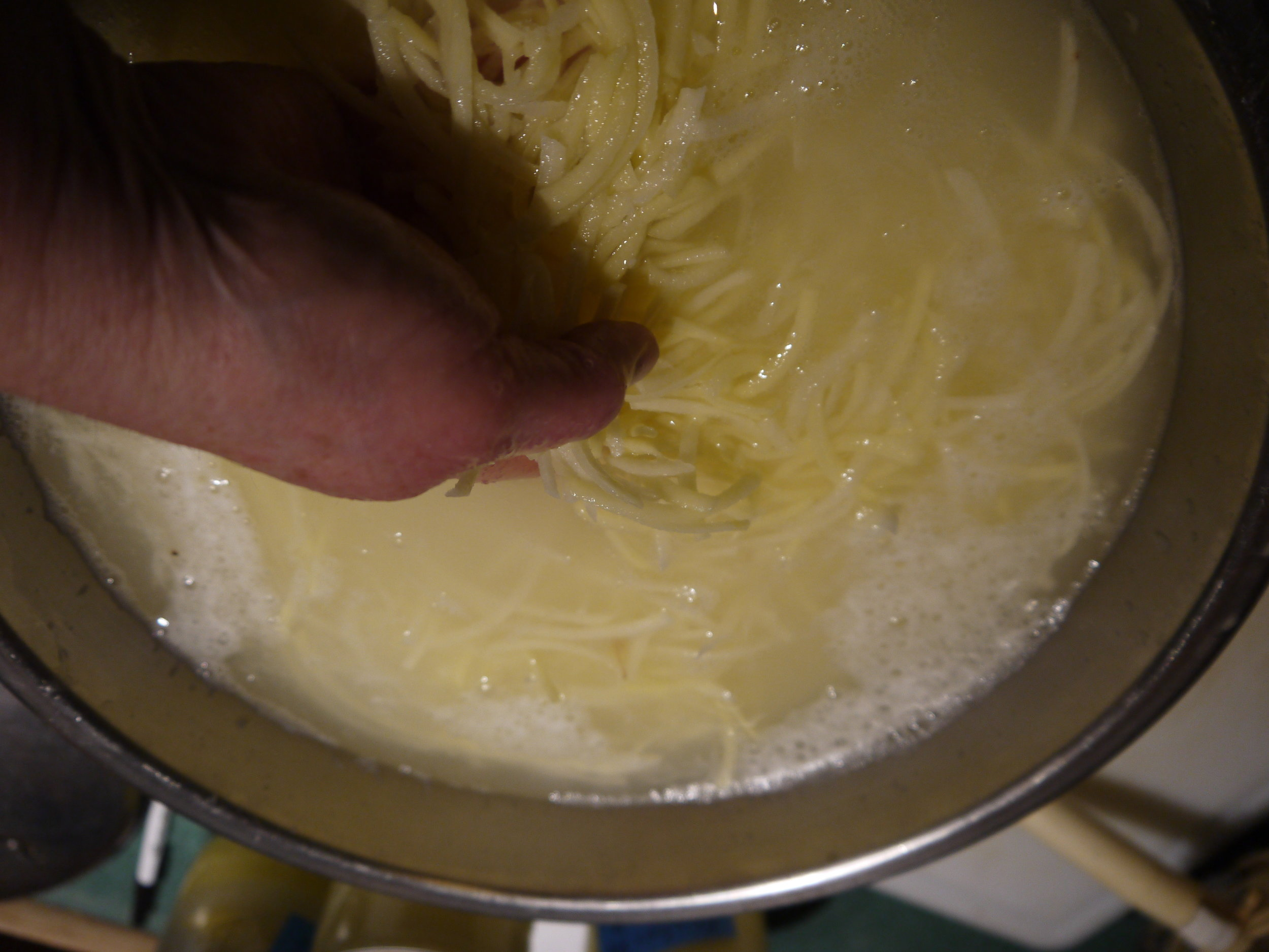 Swish the potatoes in a bowl of acidulated water and drain well.