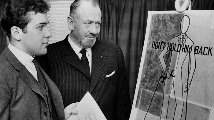 Thom (left) with his father, John (right).(AP file photo)