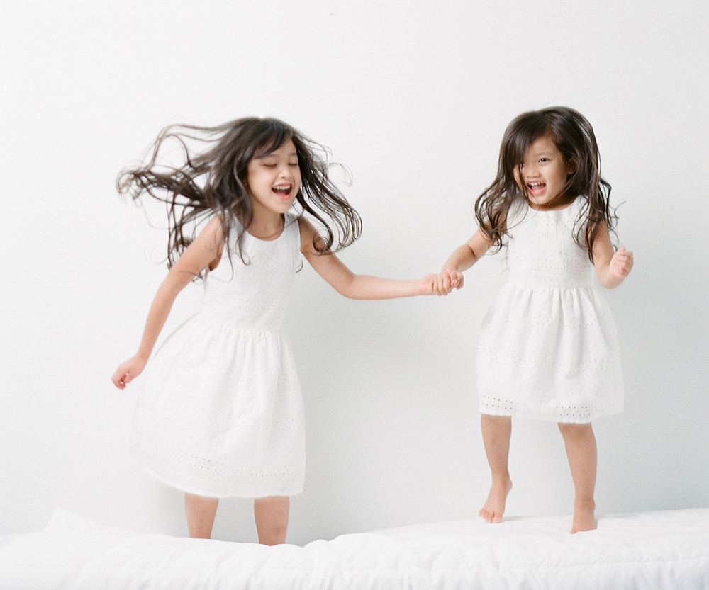 Sandra Coan | Myths that keep photographers from using off camera flash | children jumping on a bed