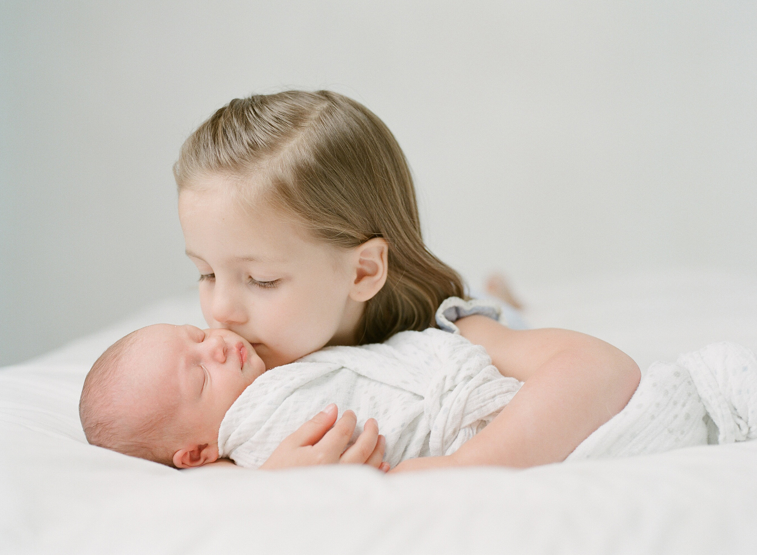 Newborn photographer Seattle | Sandra Coan | Baby and sister photographed on film