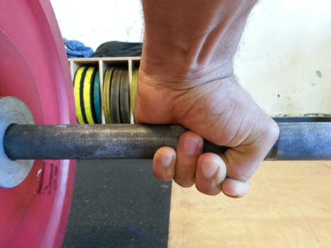 The hook grip is essential for maintaining a strong connection to the bar when lifting weights. It can take some getting used to, but once your thumb is conditioned, there is no better grip for lifting weights. Click the image to learn more about the hook grip.