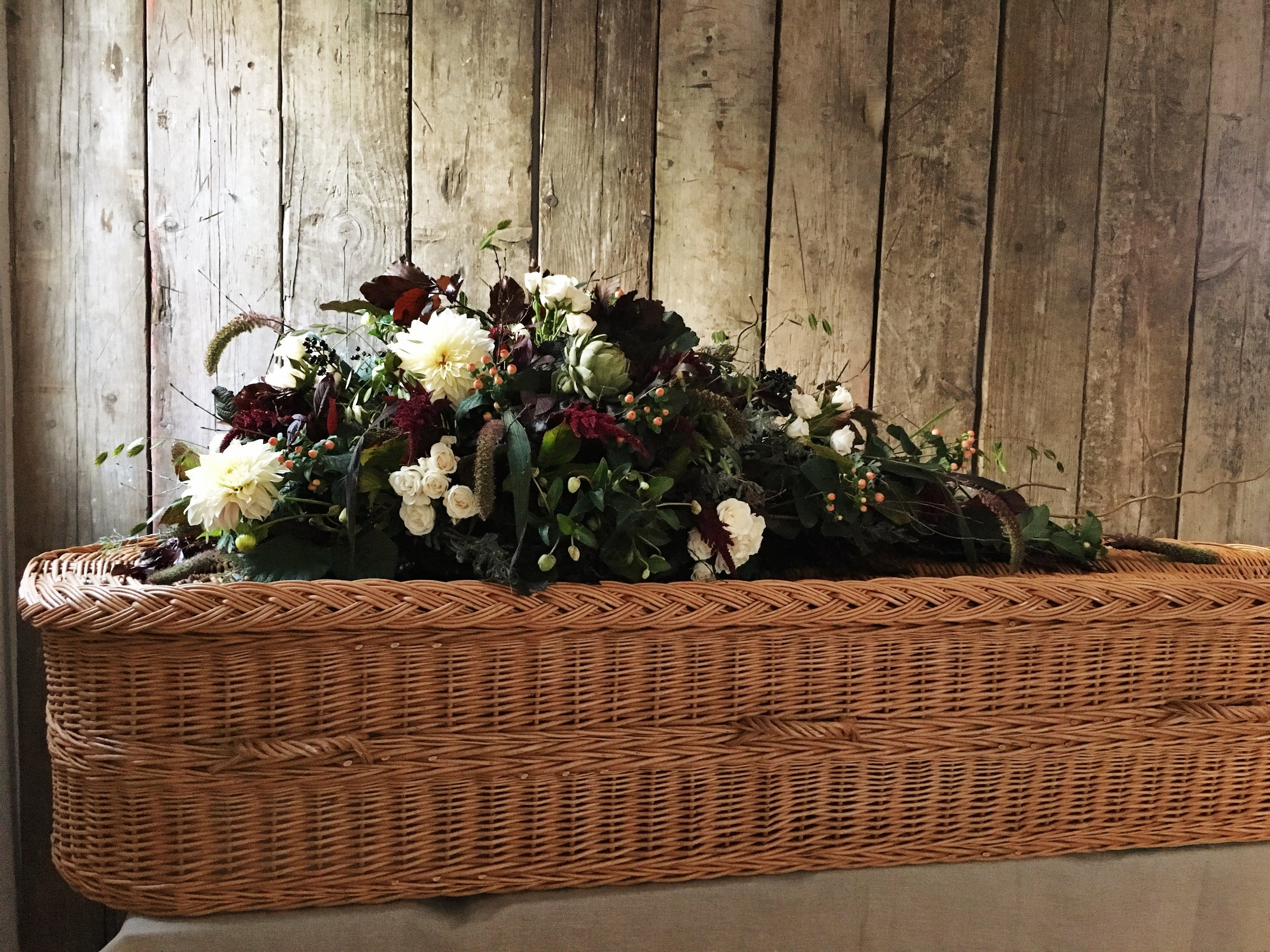 A seasonal, wild single-ended coffin spray for a natural funeral, by Bloomologie London