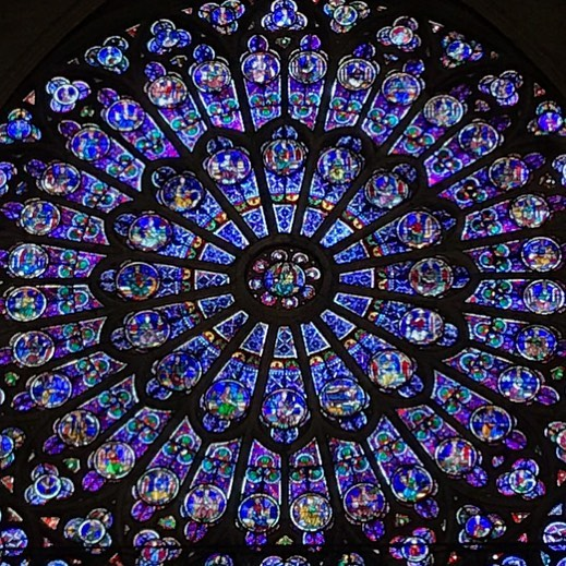 Heartbreaking evening  in Paris. I took this photo inside Notre Dame a few weeks ago. The north rose stained glass window dates from 1250.