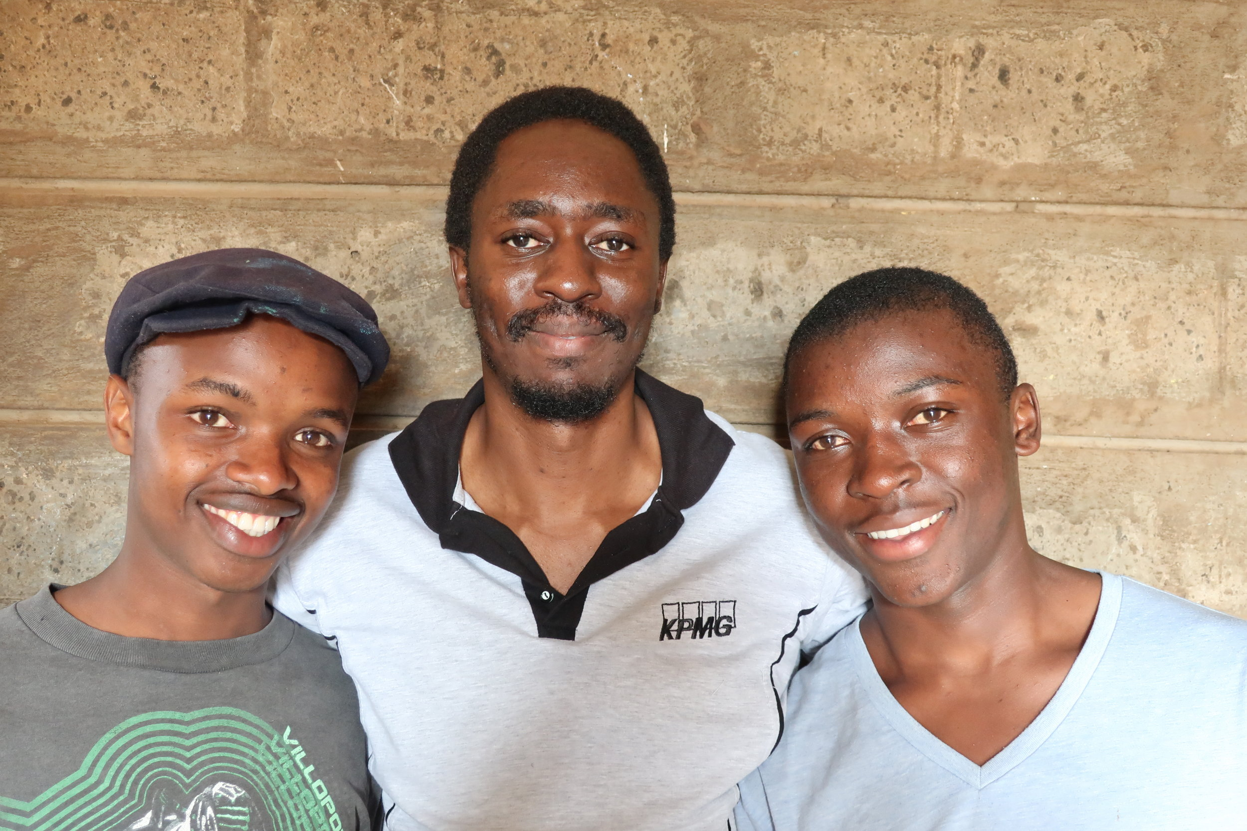 Luchiri Omoto - Luchiri is our Kenya Director, pictured here (center) with two of our seondary students. Luchiri is vital to Kawangware Kids, volunteering his time to oversee operations.