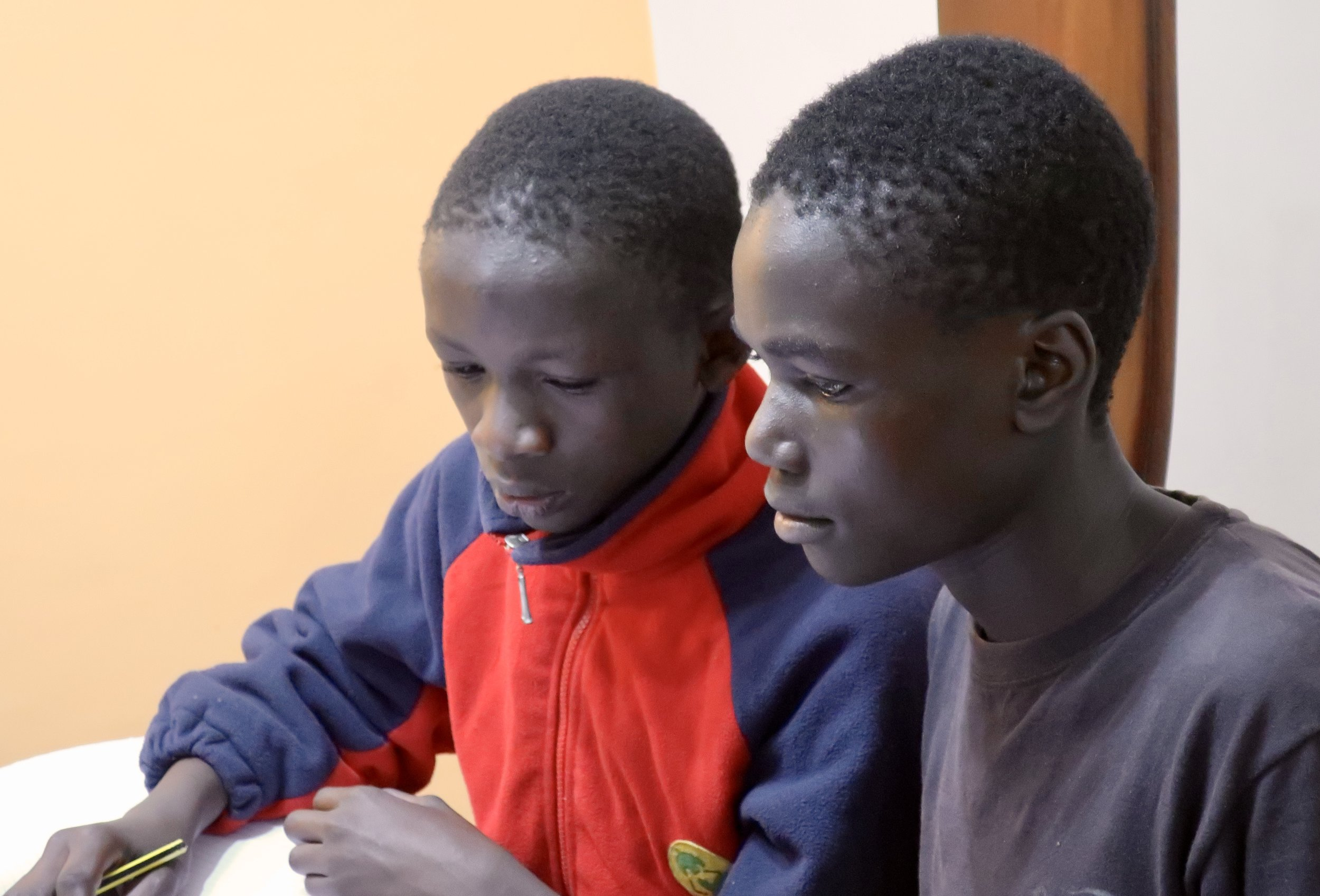 Bravin and Daniel studying during term break.
