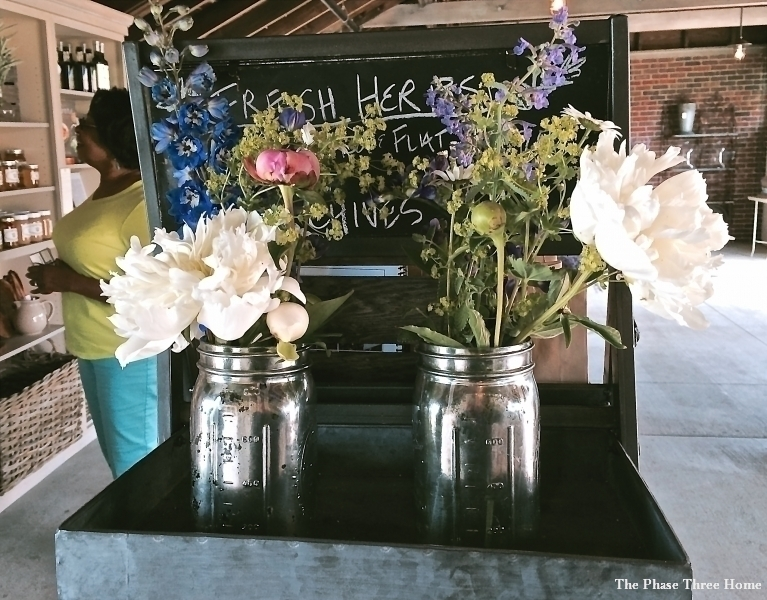 Silver painted mason jar hold gorgeous summer blooms