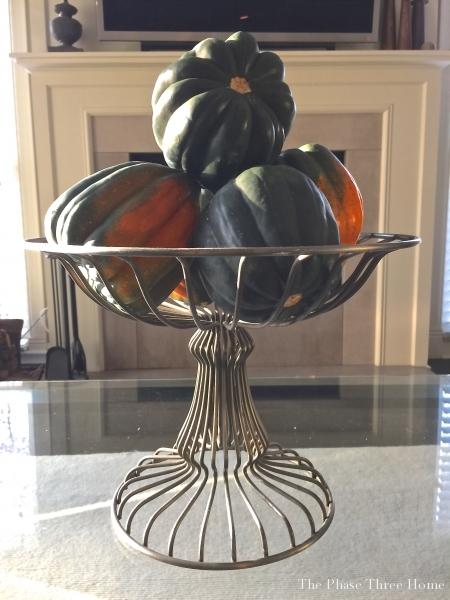 fall metal basket of acorn squash