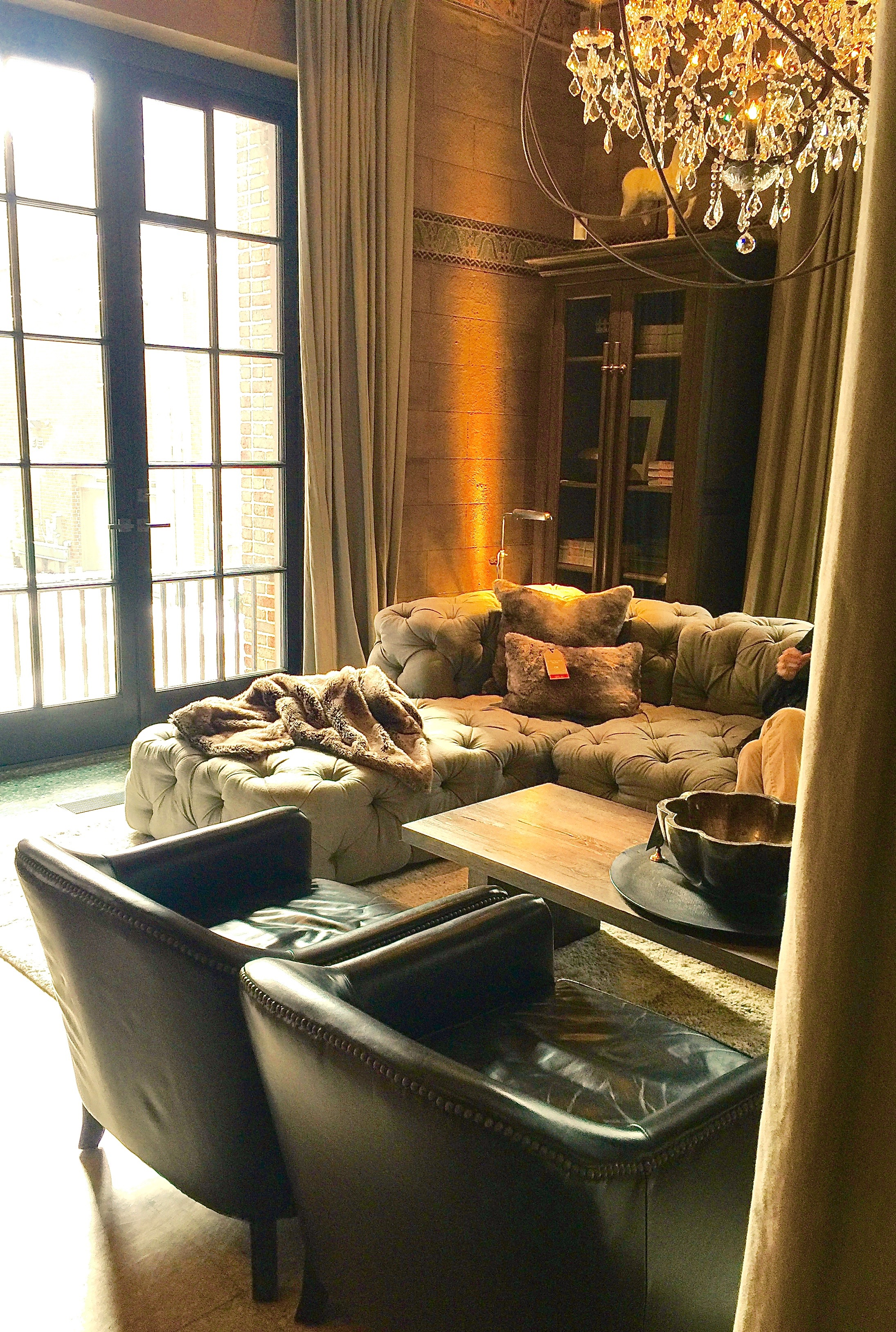 restoration hardware chicago, tufted sofa and leather side chairs, the phase three home.jpg