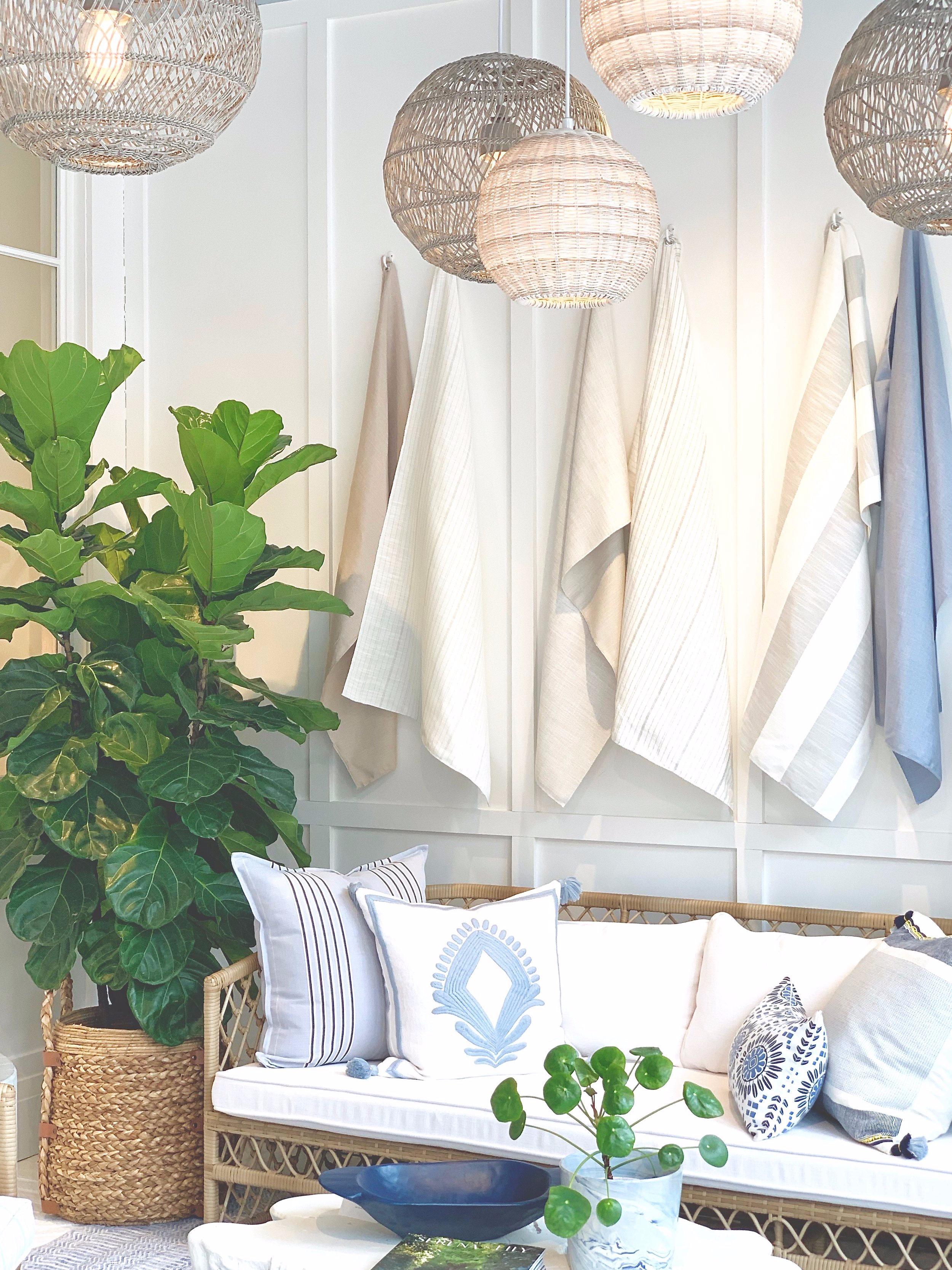 serena+and+lily+beachy+light+fixtures%2C+rattan+sofa%2C+thephasethreehome.com++.jpg