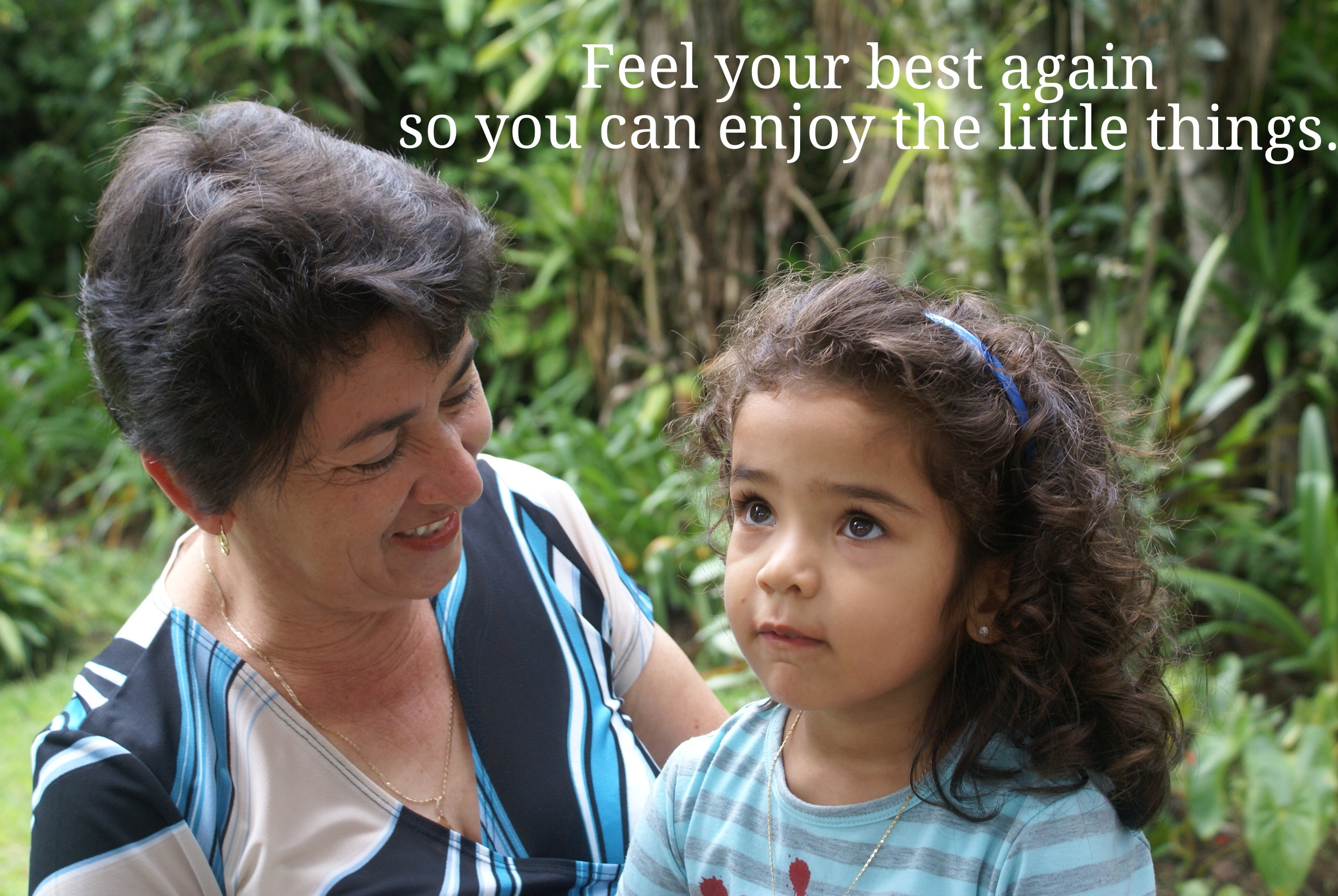 Feel your best again so you can enjoy the little things (Grandmother holds granddaughter).
