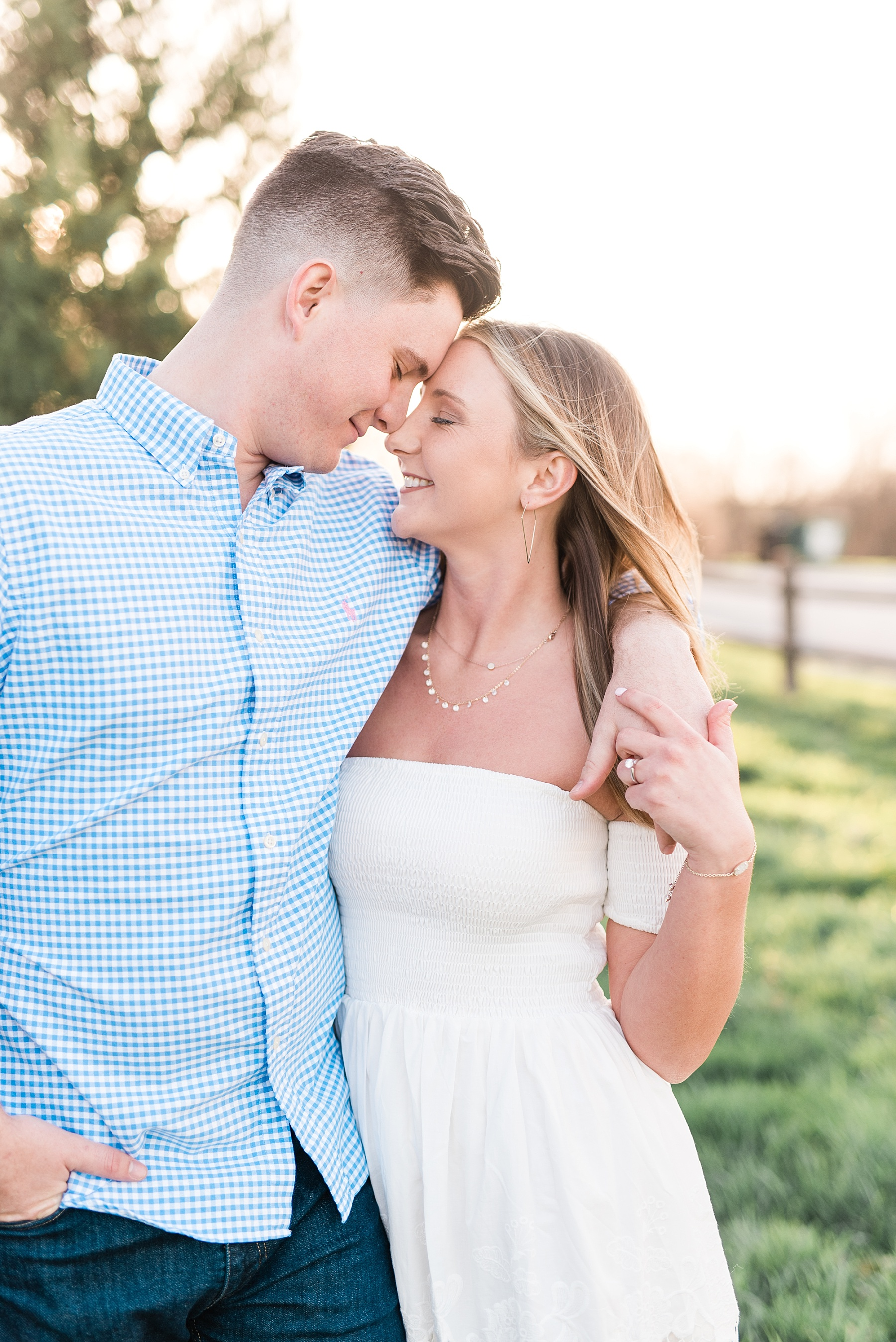 Spring Sunset Engagement Session with High School Sweethearts and Golden Retriever Puppy at Blue Bell Farm Fayette Missouri by Kelsi Kliethermes Photography_0017.jpg