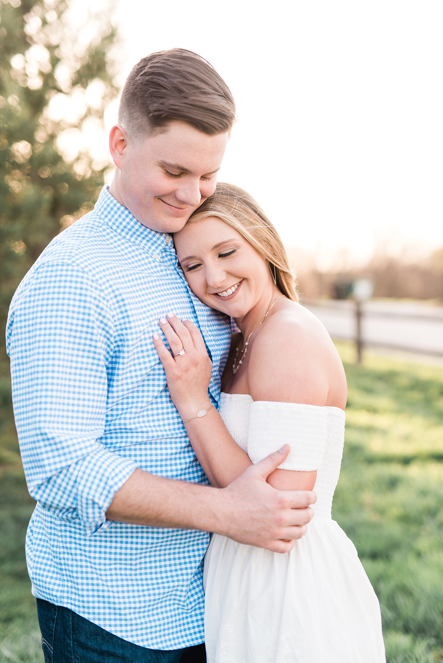 Spring Sunset Engagement Session with High School Sweethearts and Golden Retriever Puppy at Blue Bell Farm Fayette Missouri by Kelsi Kliethermes Photography_0018.jpg