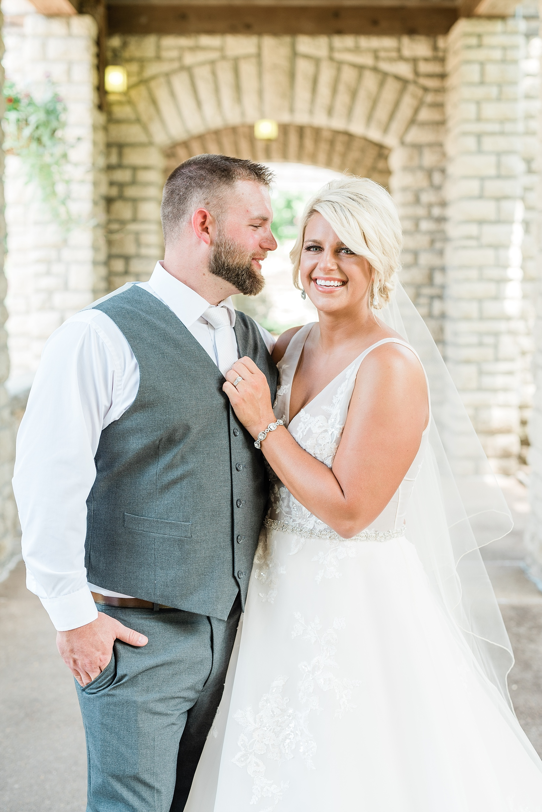 Rose Gold, White, and Greenery High Class Summer Wedding at The Millbottom in Downtown Jefferson City by Kelsi Kliethermes Photography_0024.jpg