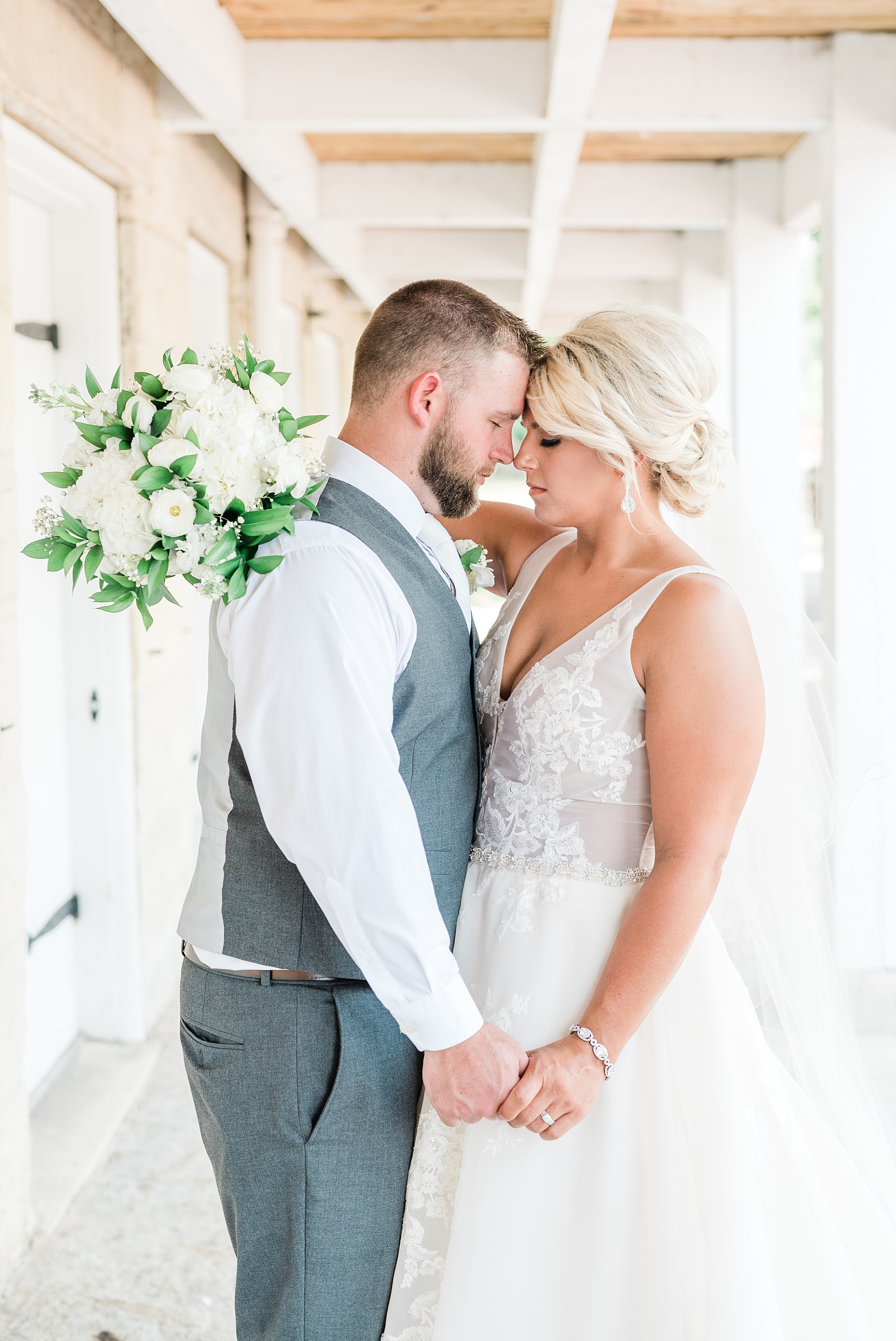 Rose Gold, White, and Greenery High Class Summer Wedding at The Millbottom in Downtown Jefferson City by Kelsi Kliethermes Photography_0028.jpg