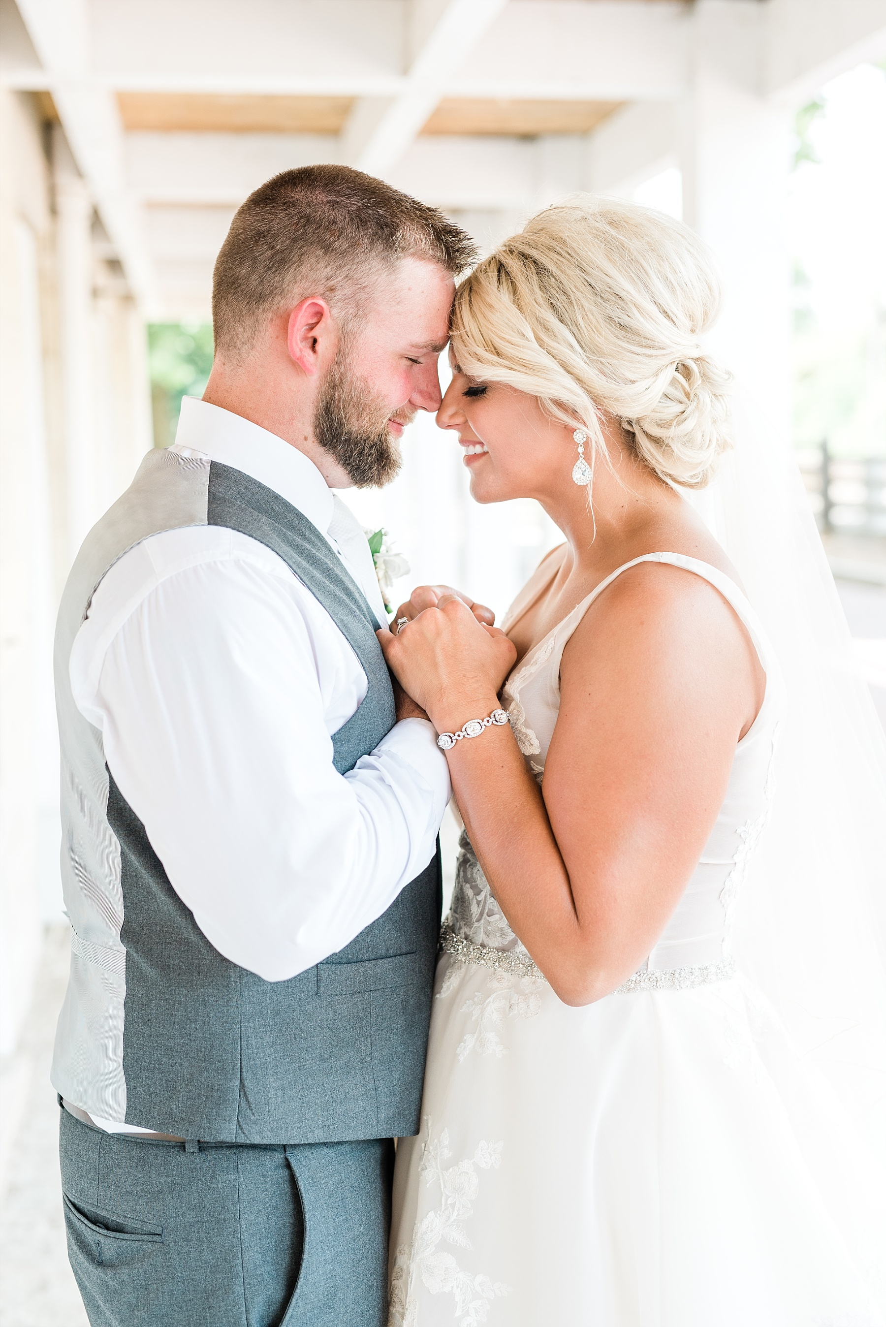 Rose Gold, White, and Greenery High Class Summer Wedding at The Millbottom in Downtown Jefferson City by Kelsi Kliethermes Photography_0029.jpg