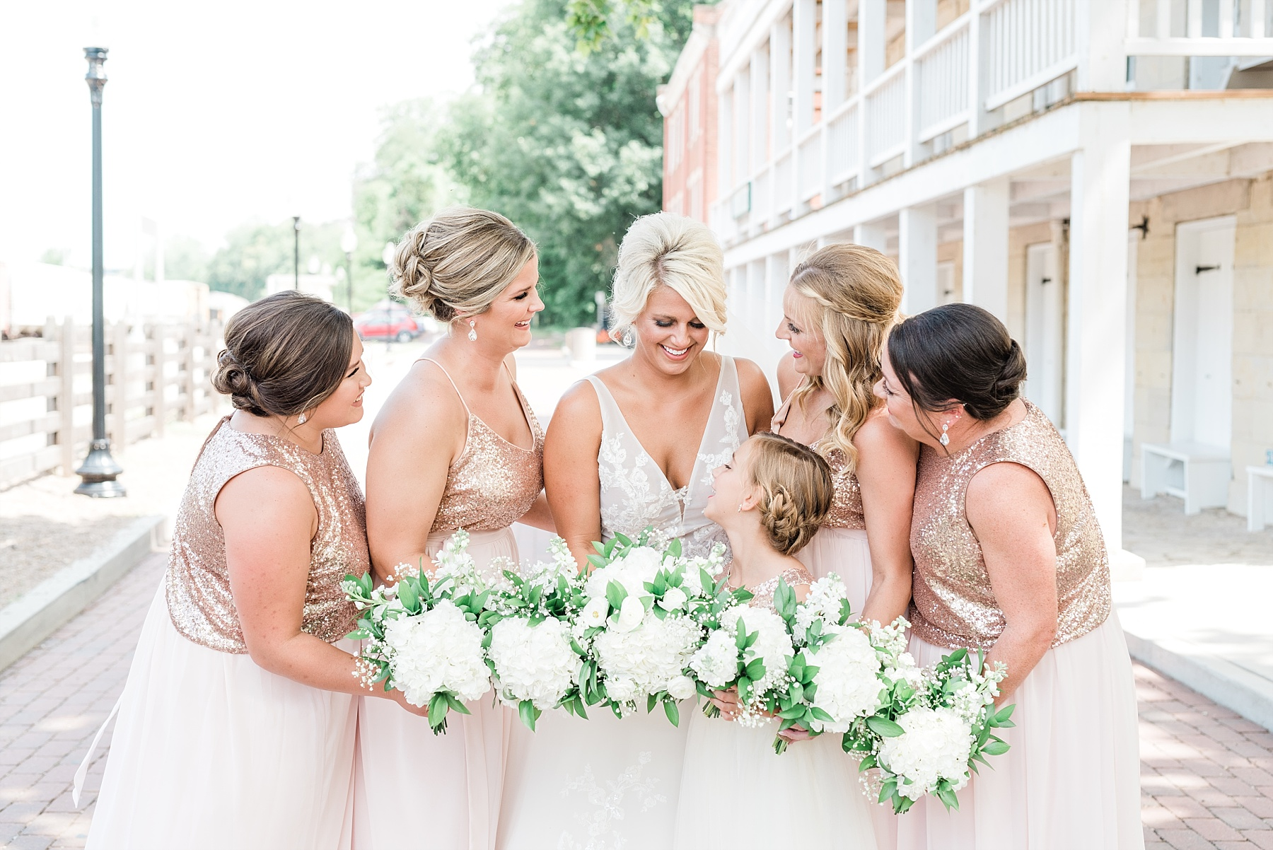 Rose Gold, White, and Greenery High Class Summer Wedding at The Millbottom in Downtown Jefferson City by Kelsi Kliethermes Photography_0033.jpg
