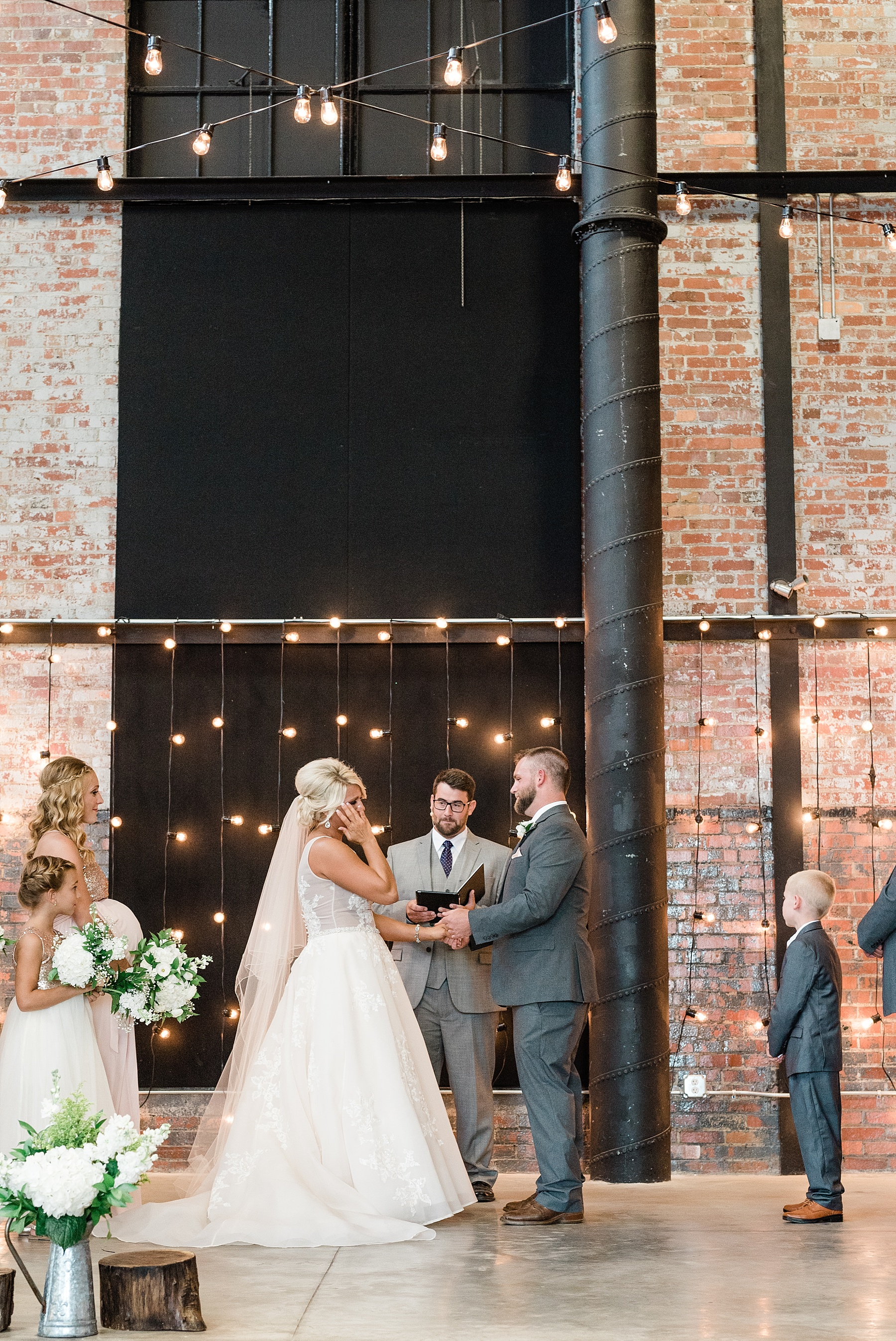 Rose Gold, White, and Greenery High Class Summer Wedding at The Millbottom in Downtown Jefferson City by Kelsi Kliethermes Photography_0043.jpg