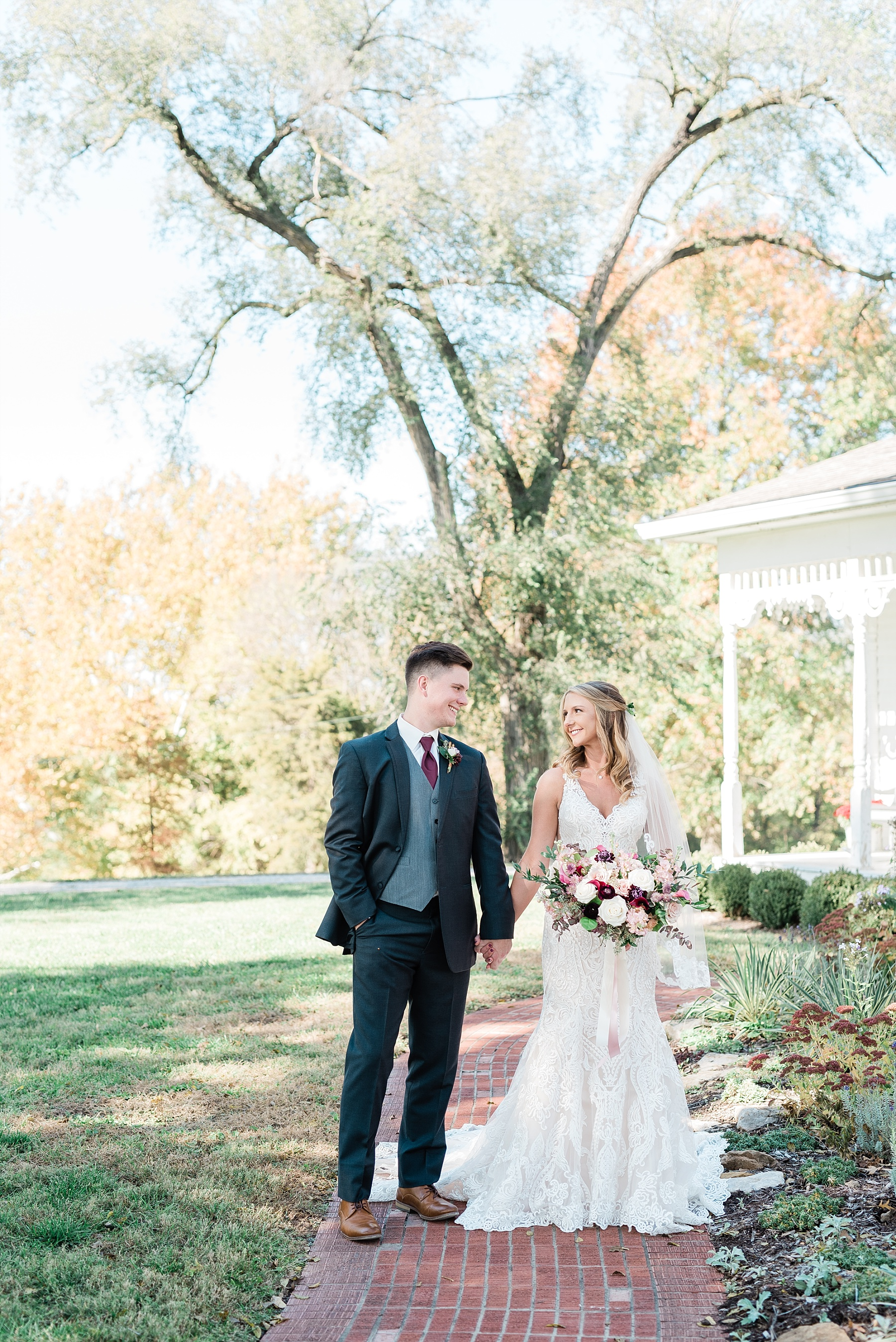 Golden Autumn Outdoor Wedding with Ivory, Bergundy, and Blush Color Palette at Blue Bell Farms  by Kelsi Kliethermes Photography_0076.jpg