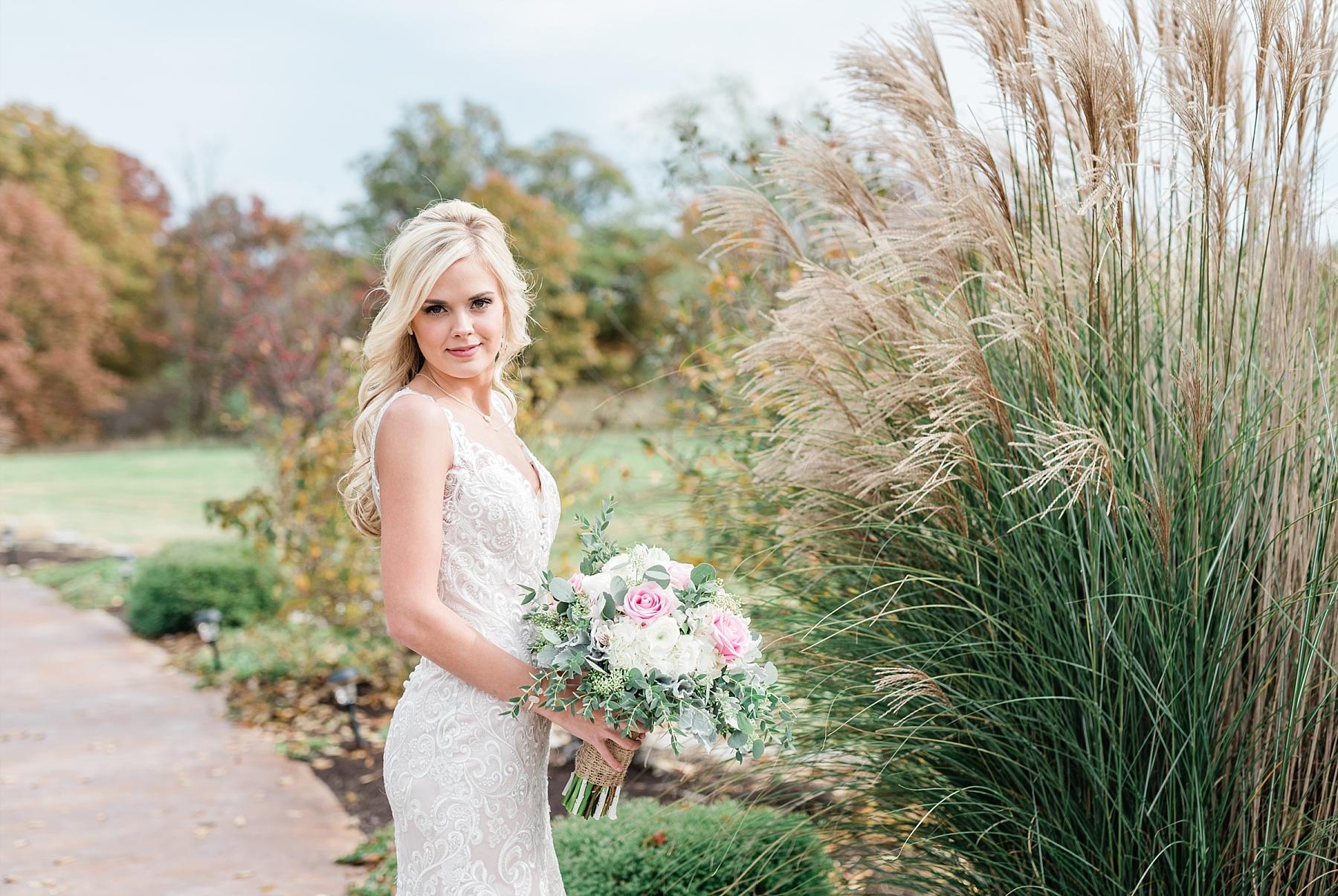 bride on pampas grass pathway fall wedding