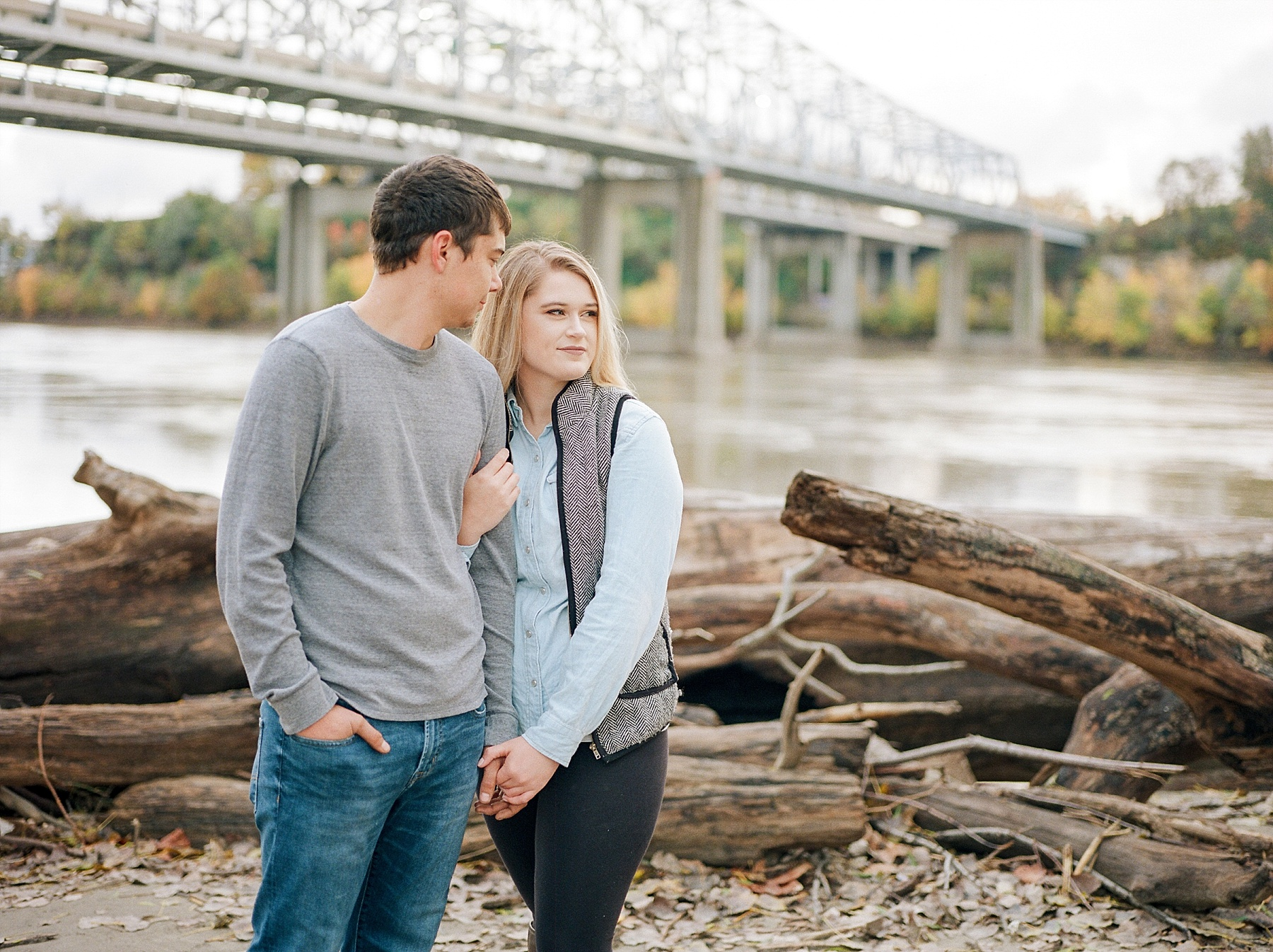 Couple Standing Among Driftwood On Shore Of Missouri River Jefferson City Missouri