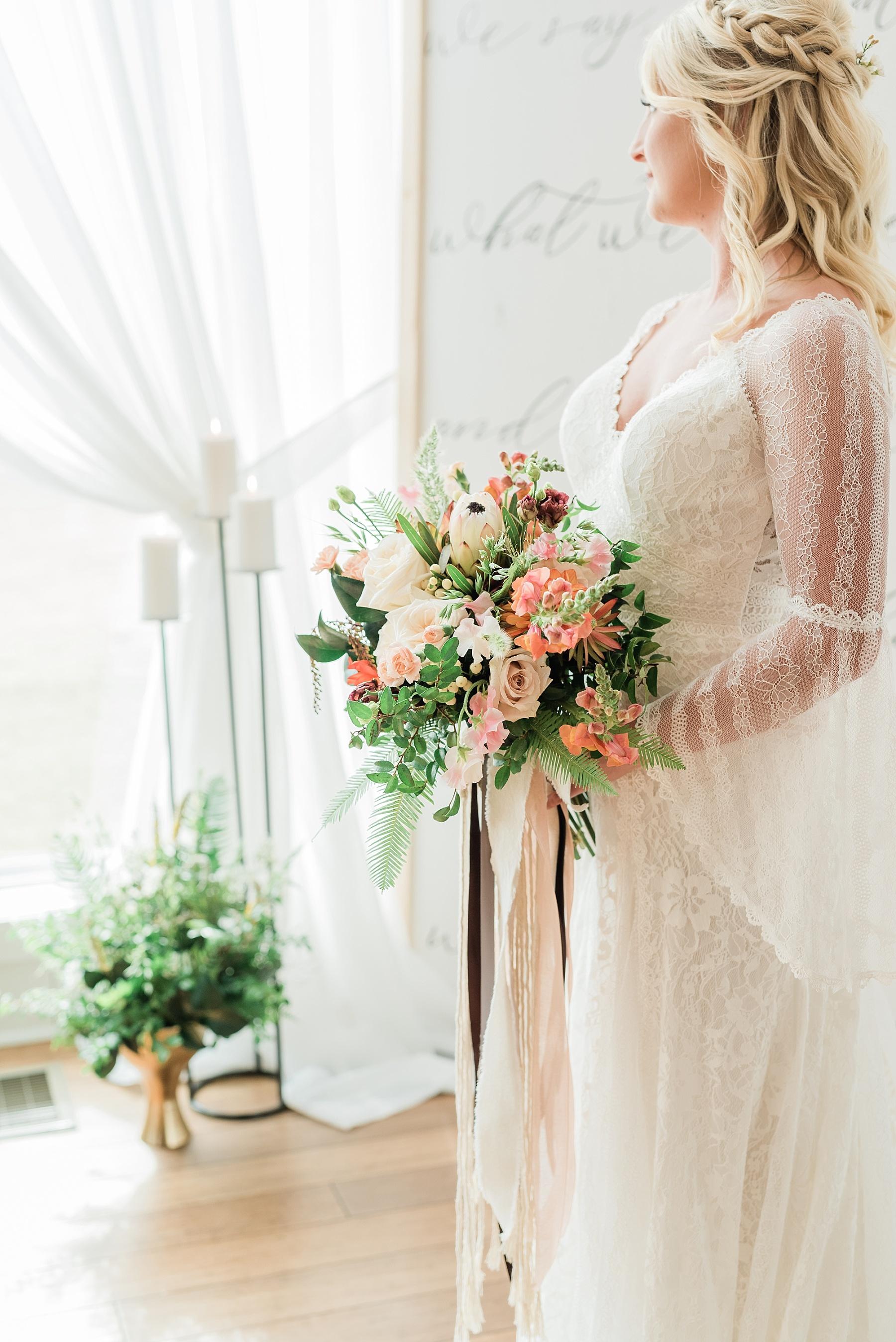 Eclectic Scandinavian Winter Wedding in All White Venue Emerson Fields by Kelsi Kliethermes Photography Best Missouri and Maui Wedding Photographer_0085.jpg