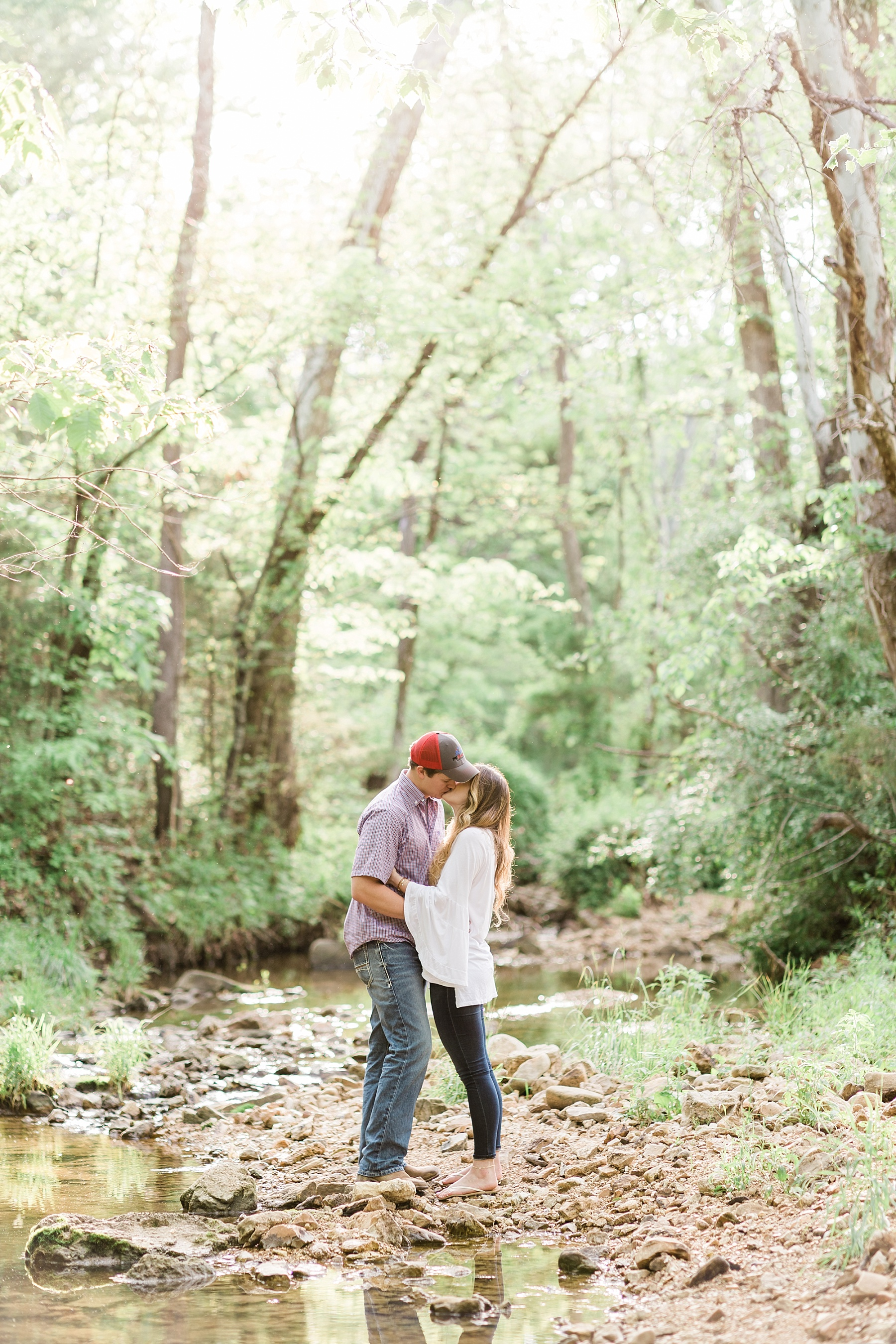 Spring Engagement Session in Open Field at Sunset by Kelsi Kliethermes Photography Best Missouri and Maui Wedding Photographer_0004.jpg