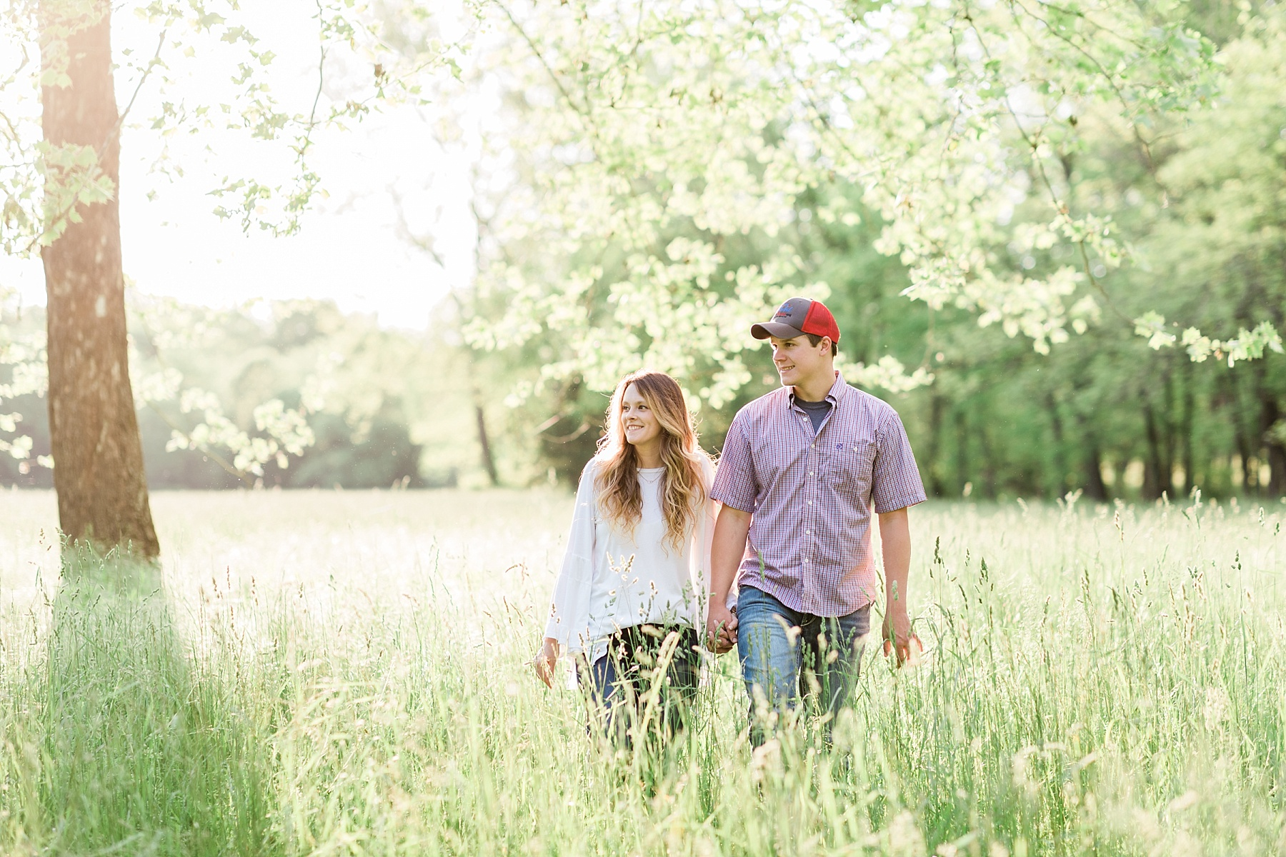 Spring Engagement Session in Open Field at Sunset by Kelsi Kliethermes Photography Best Missouri and Maui Wedding Photographer_0005.jpg