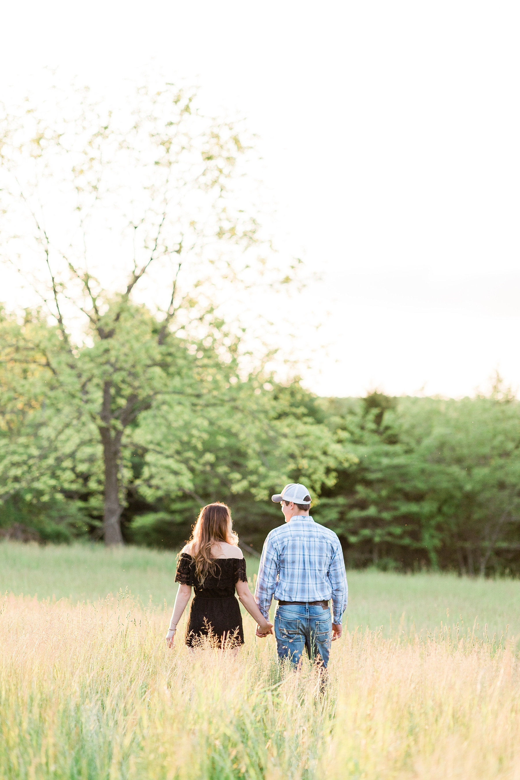 Spring Engagement Session in Open Field at Sunset by Kelsi Kliethermes Photography Best Missouri and Maui Wedding Photographer_0009.jpg
