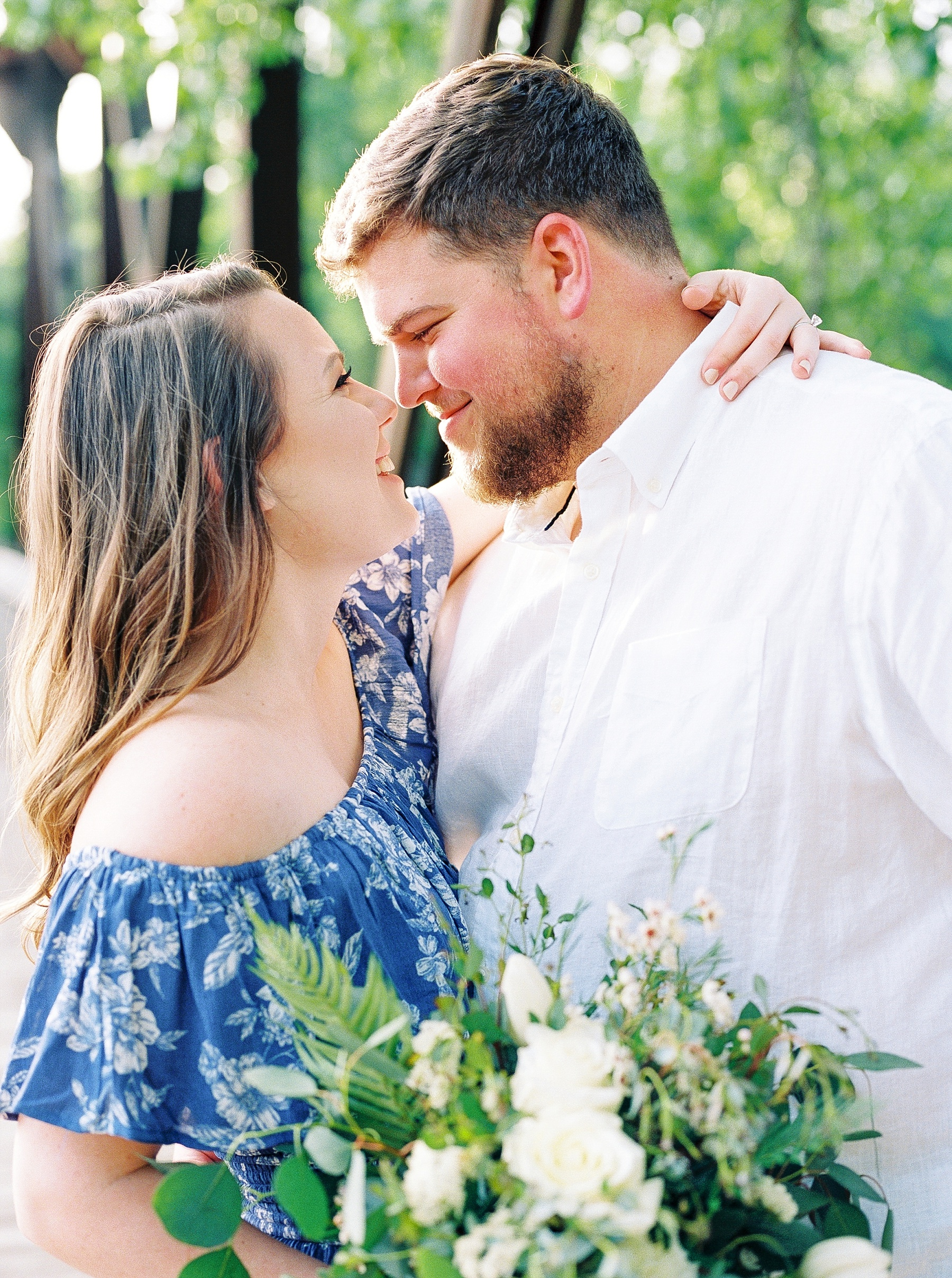Flirty Spring Engagement Session with Floral Bouquet at Cooper's Landing by Kelsi Kliethermes Photography Best Missouri and Maui Wedding Photographer_0015.jpg