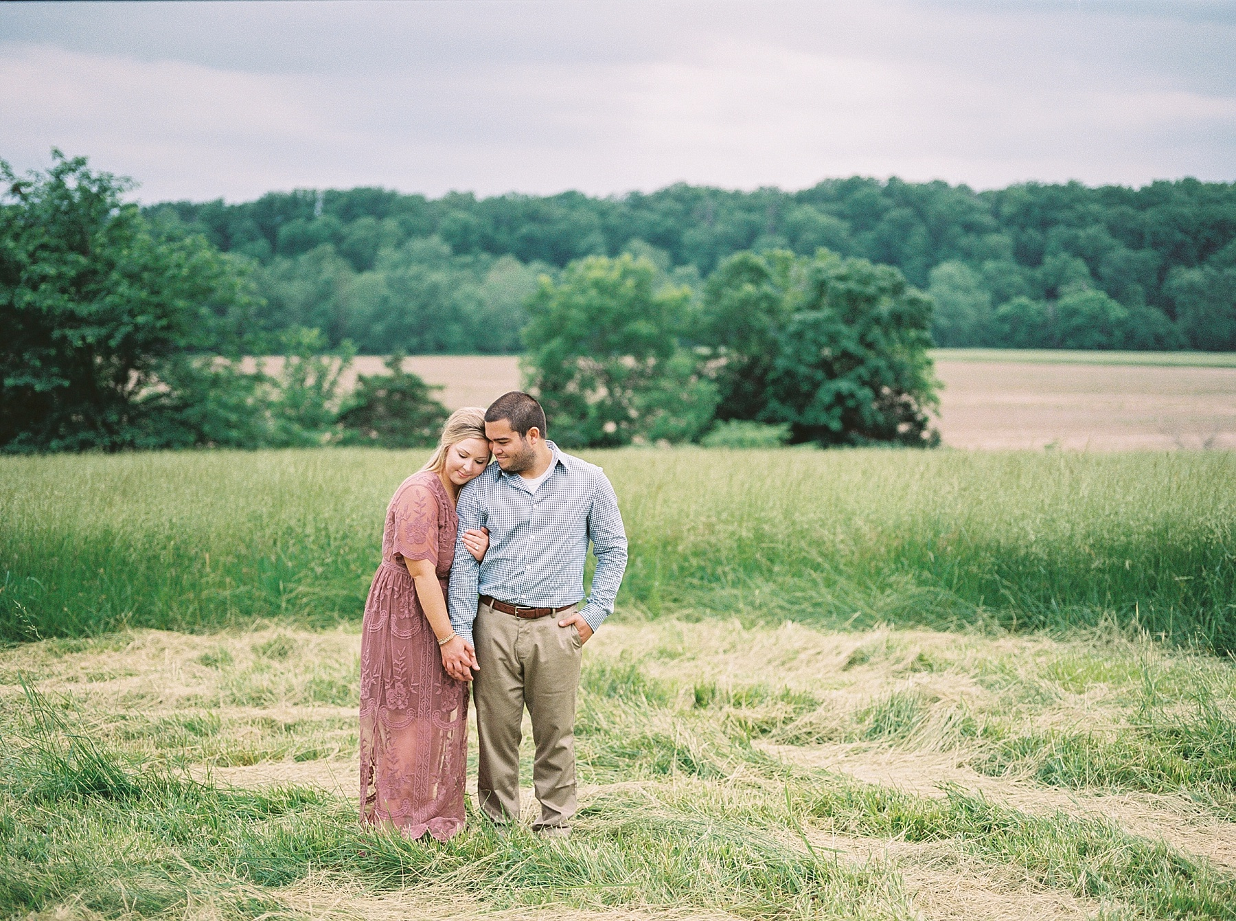 Dusty Rose and Deep Green Rolling Hills Engagement Session by Kelsi Kliethermes Photography Best Missouri and Maui Wedding Photographer_0005.jpg