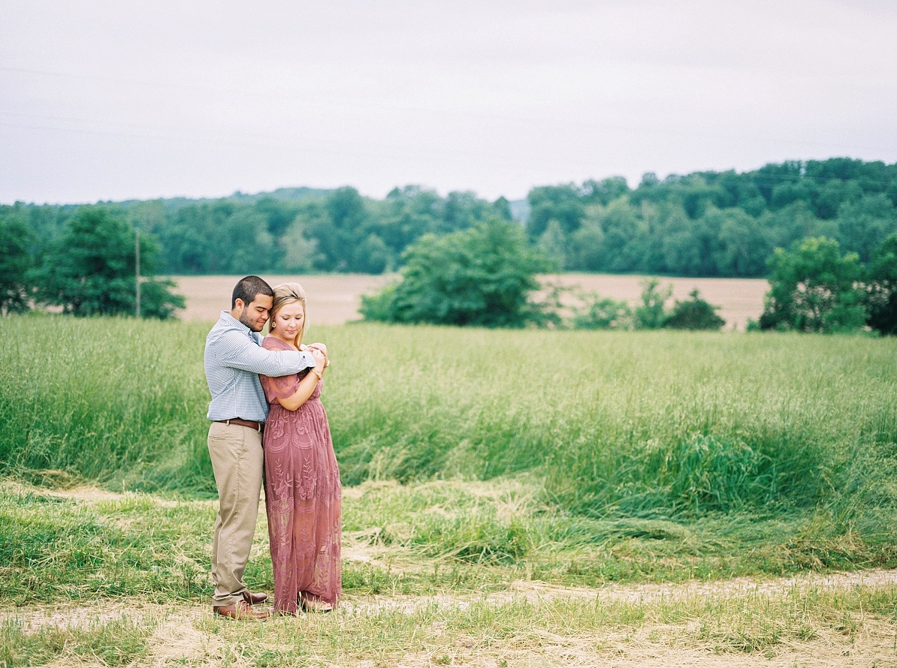 Dusty Rose and Deep Green Rolling Hills Engagement Session by Kelsi Kliethermes Photography Best Missouri and Maui Wedding Photographer_0007.jpg