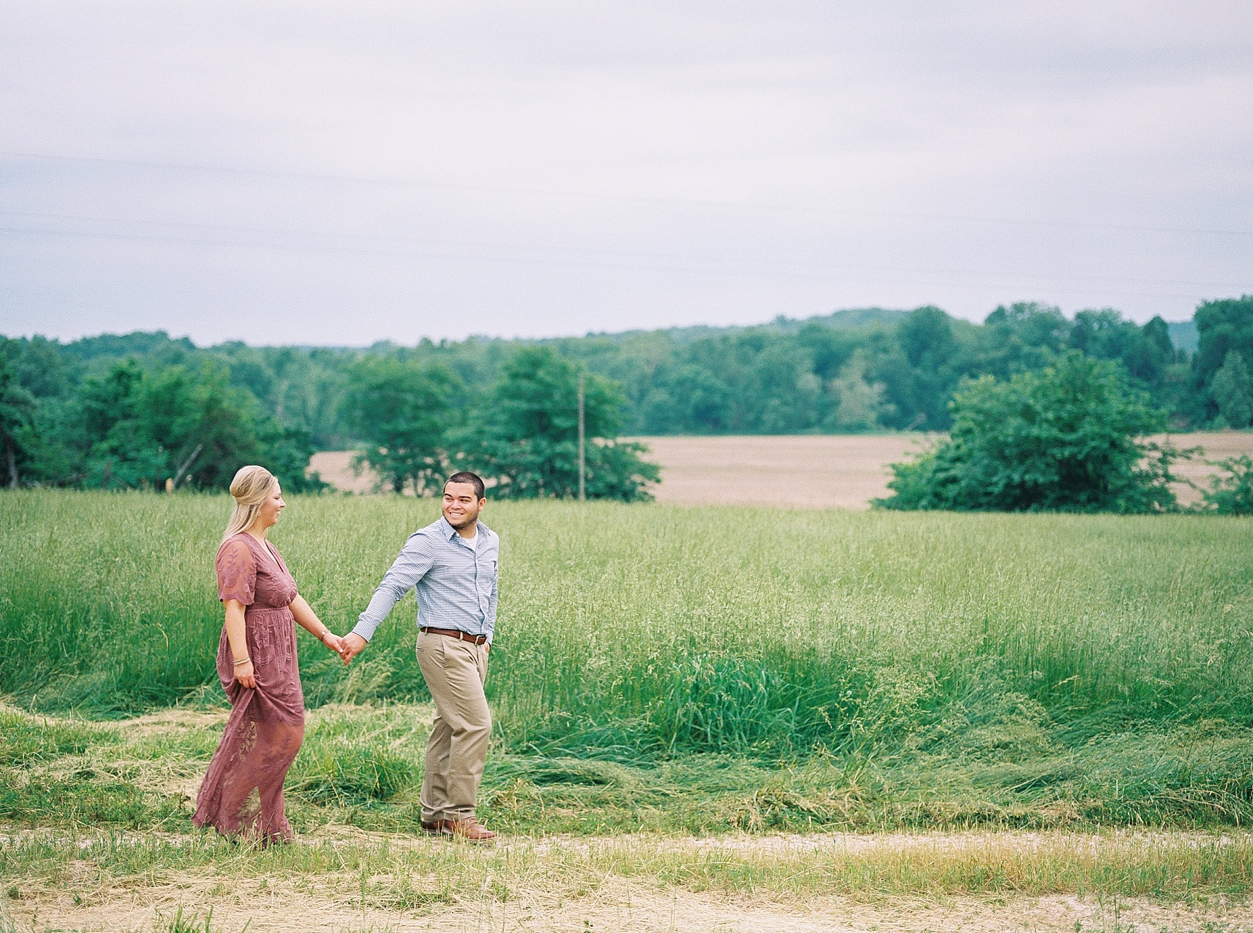 Dusty Rose and Deep Green Rolling Hills Engagement Session by Kelsi Kliethermes Photography Best Missouri and Maui Wedding Photographer_0008.jpg
