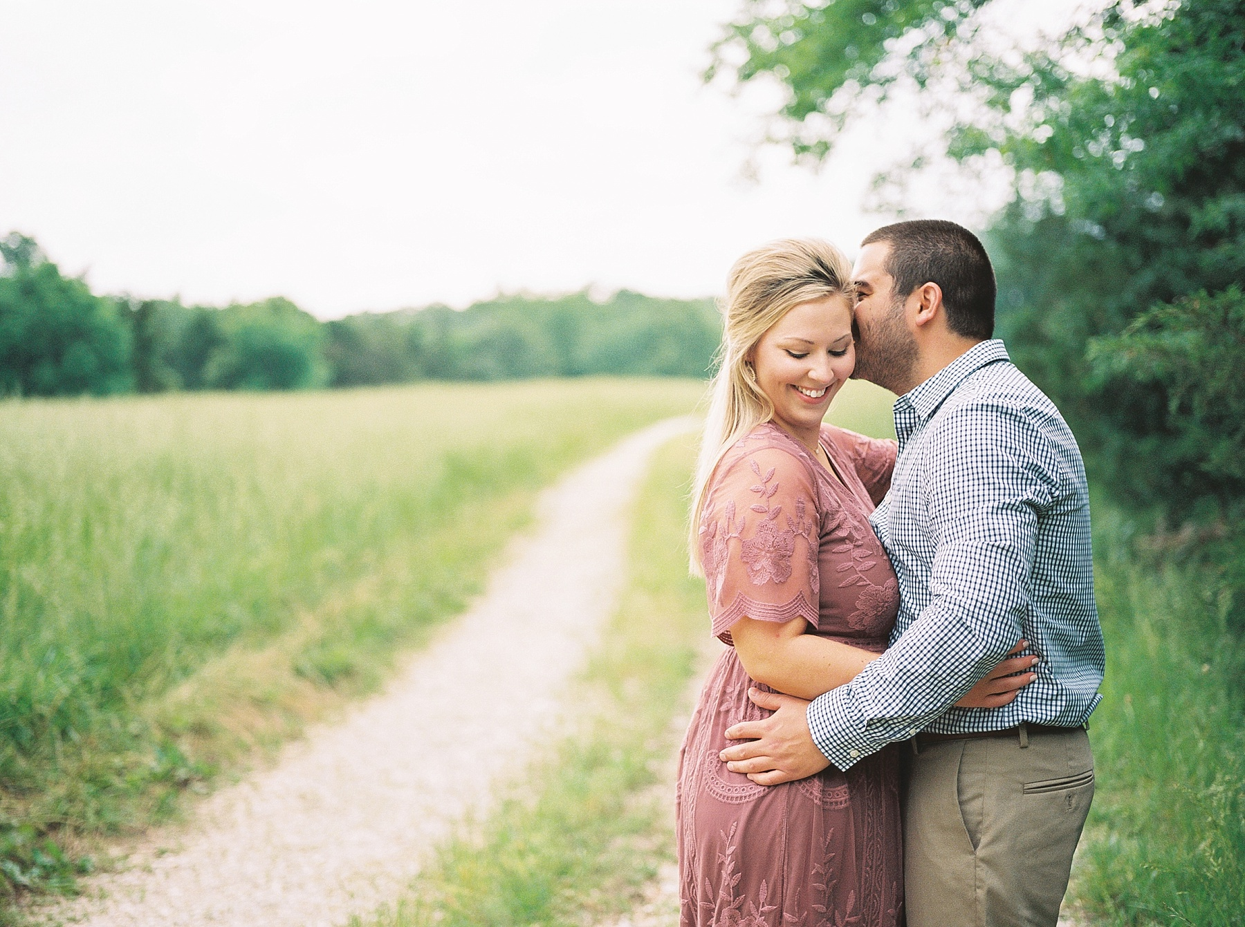 Dusty Rose and Deep Green Rolling Hills Engagement Session by Kelsi Kliethermes Photography Best Missouri and Maui Wedding Photographer_0009.jpg